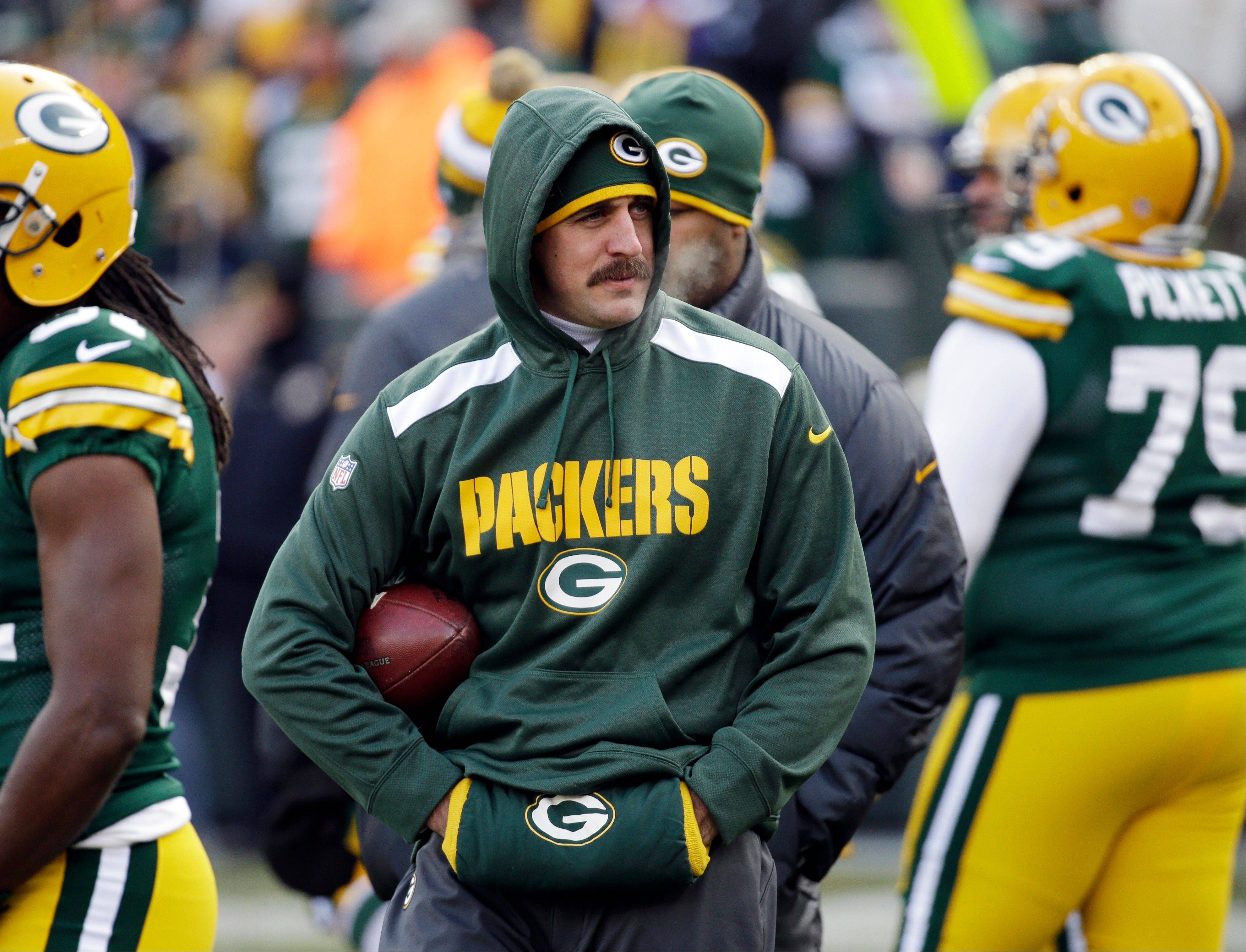Packers quarterback Aaron Rodgers is taking off the hoodie and putting on the helmet for Sunday's NFC North matchup with the Bears.