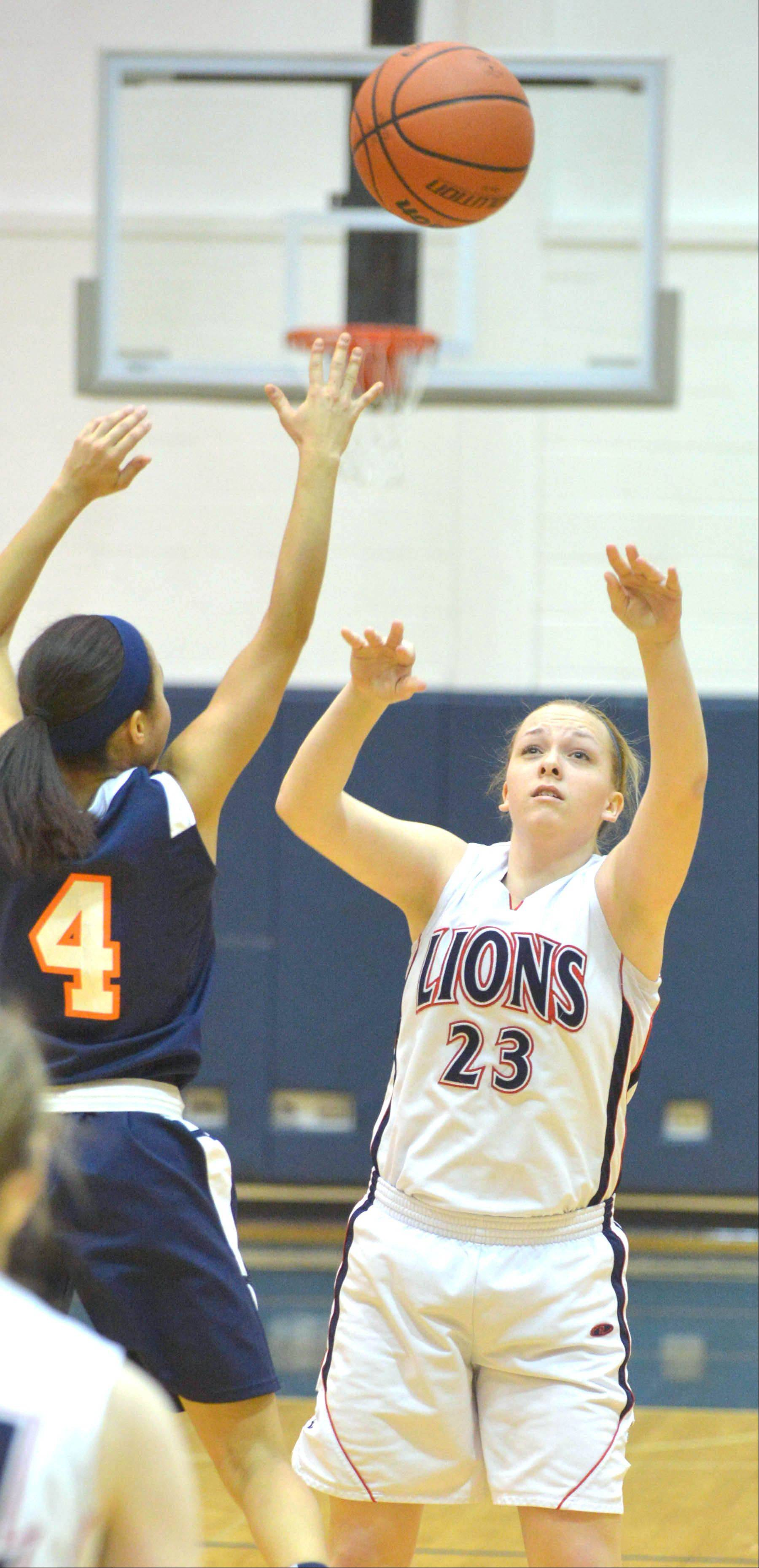 Sierra Birdsell of Lisle puts up a shot during the Latin at Lisle girls basketball game Thursday.