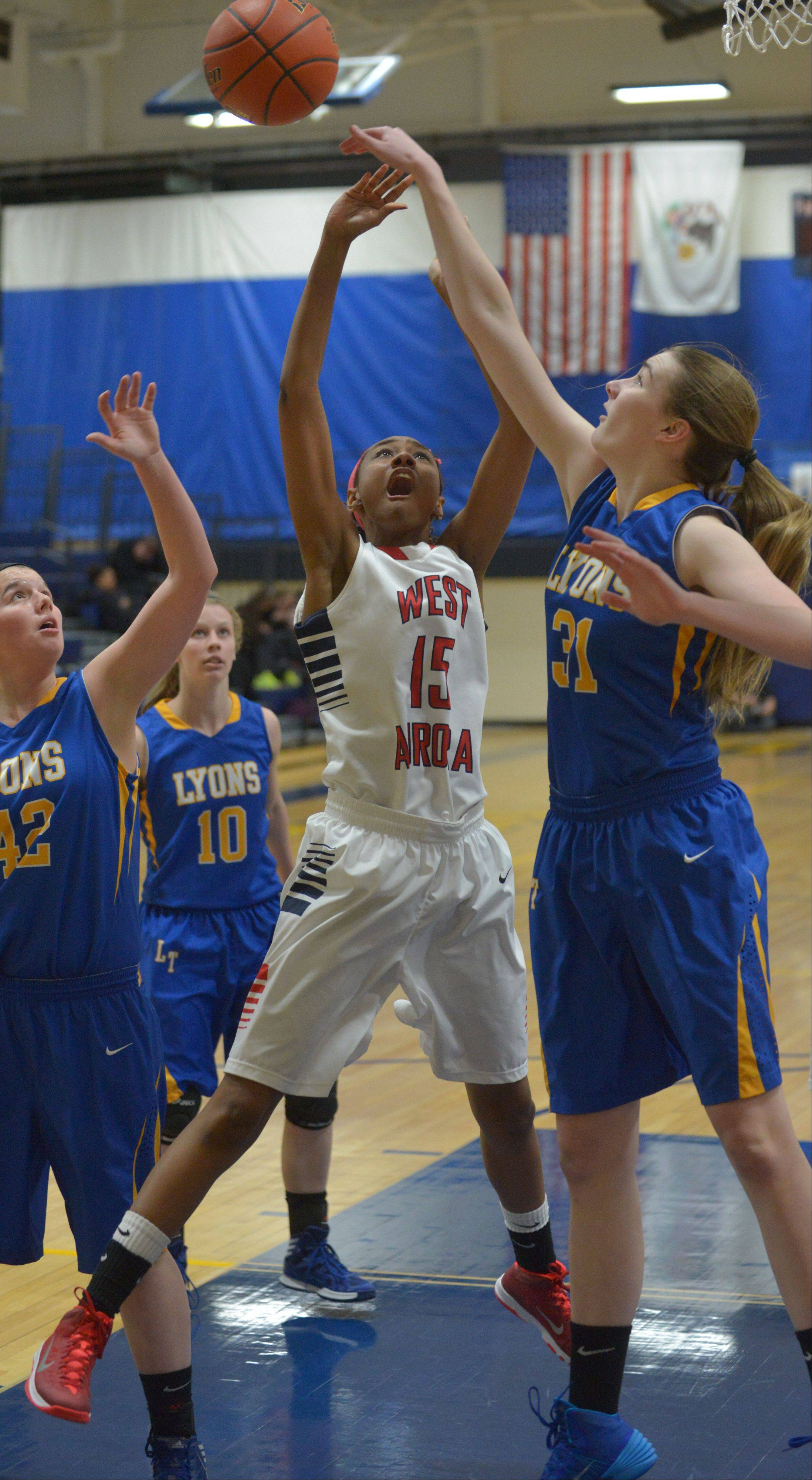 Images from the West Aurora vs. Wheaton North girls basketball game on Thursday, Dec. 26, 2013.