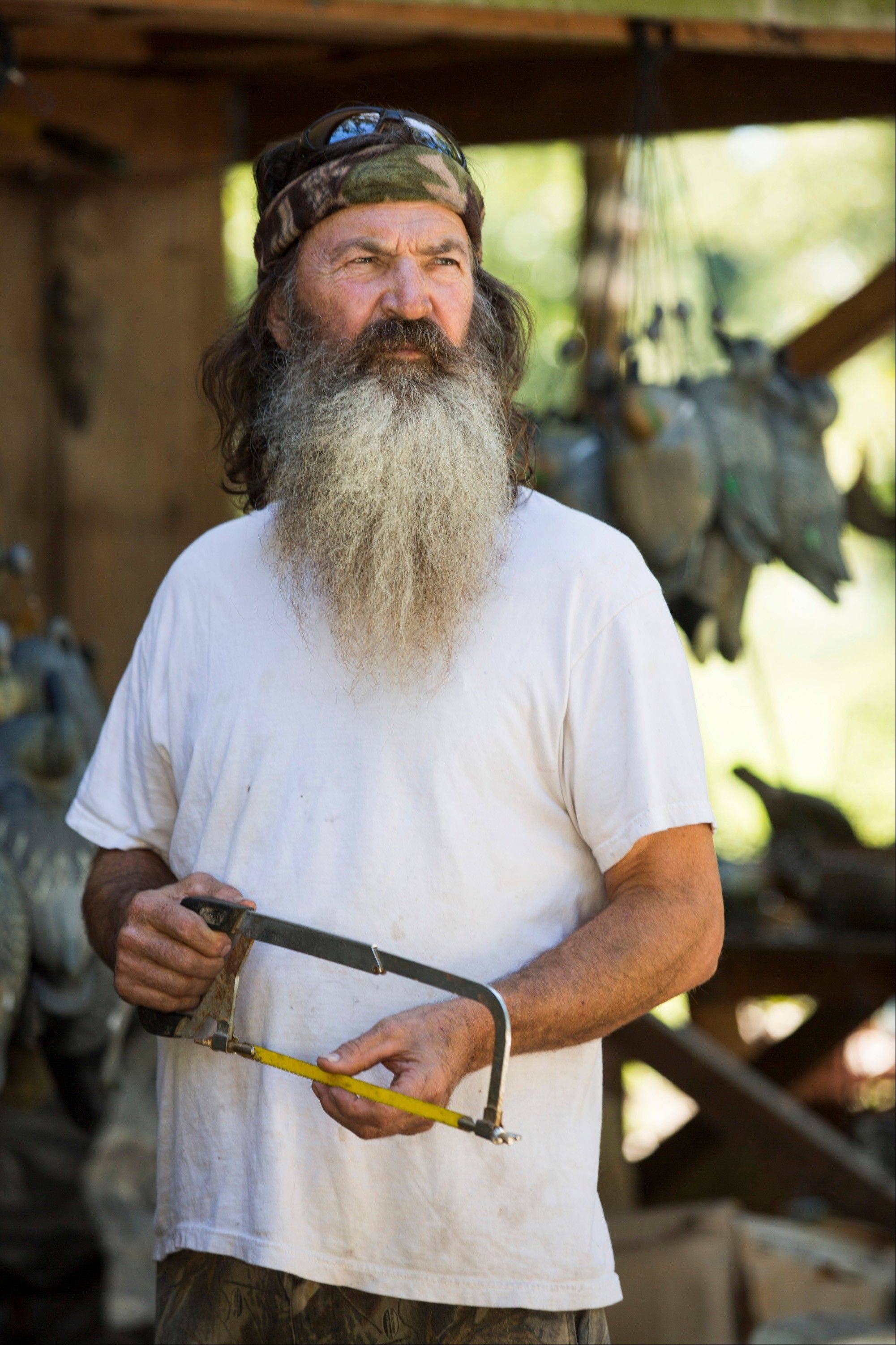 "Phil Robertson was suspended from ""Duck Dynasty"" for disparaging comments he made to GQ magazine about gay people but was reinstated by the A&E network in a statement Friday."