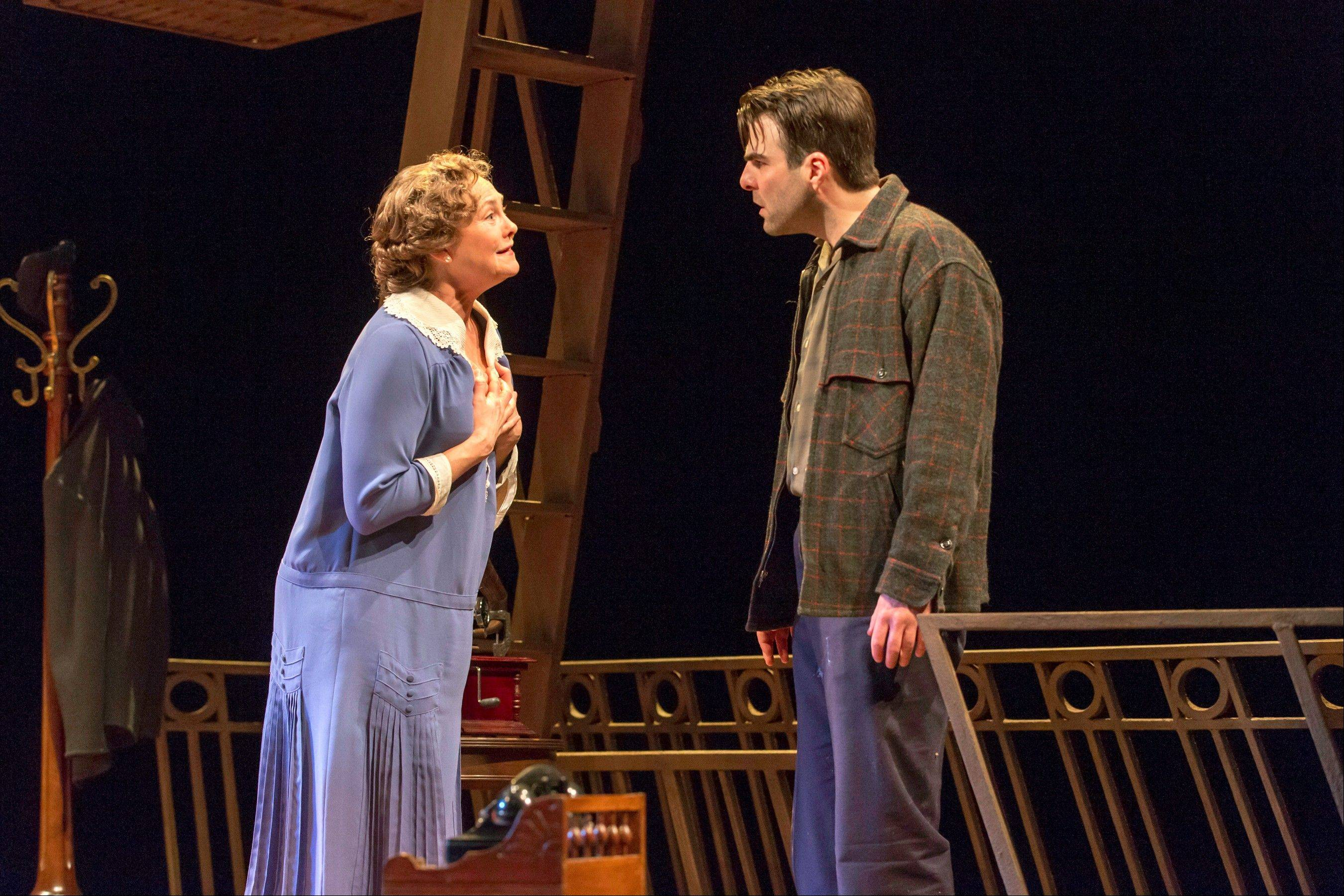 "This theater image released by Jeffrey Richards Associates shows Cherry Jones, left, and Zachary Quinto during a performance of ""The Glass Menagerie."" There's magic from start to finish in this new production of Tennessee William's great play about regret starring a superb Cherry Jones and a revelatory Zachary Quinto. It's evocative, sometimes surreal and sublimely organic _ the perfect package for a play about faded and frayed memories."