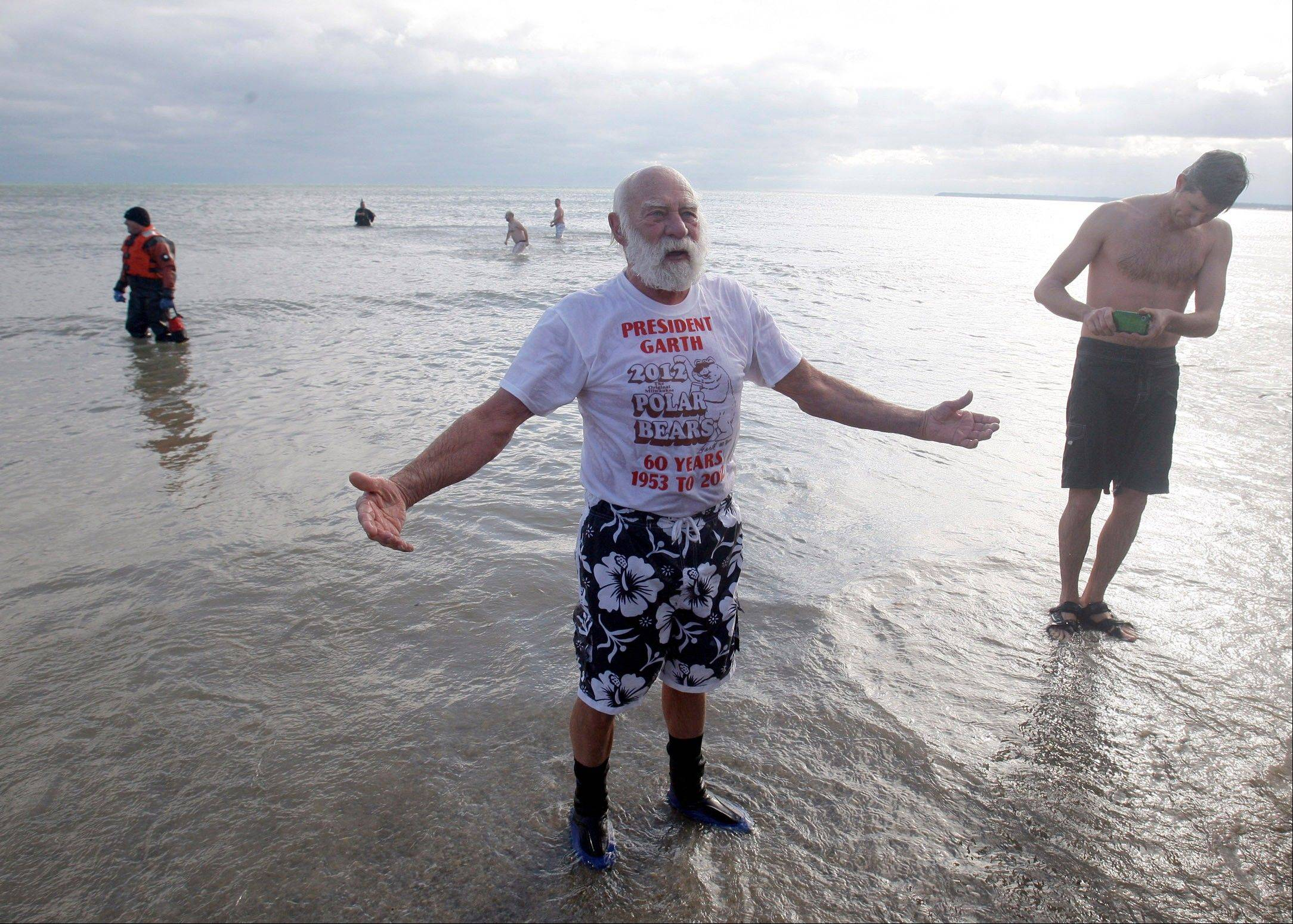 Garth Gaskey, 82 of Brookfield, Wis., emerges after taking a cold swim in Lake Michigan during the annual New Year's Day Polar Dip at Bradford Beach, Wis.