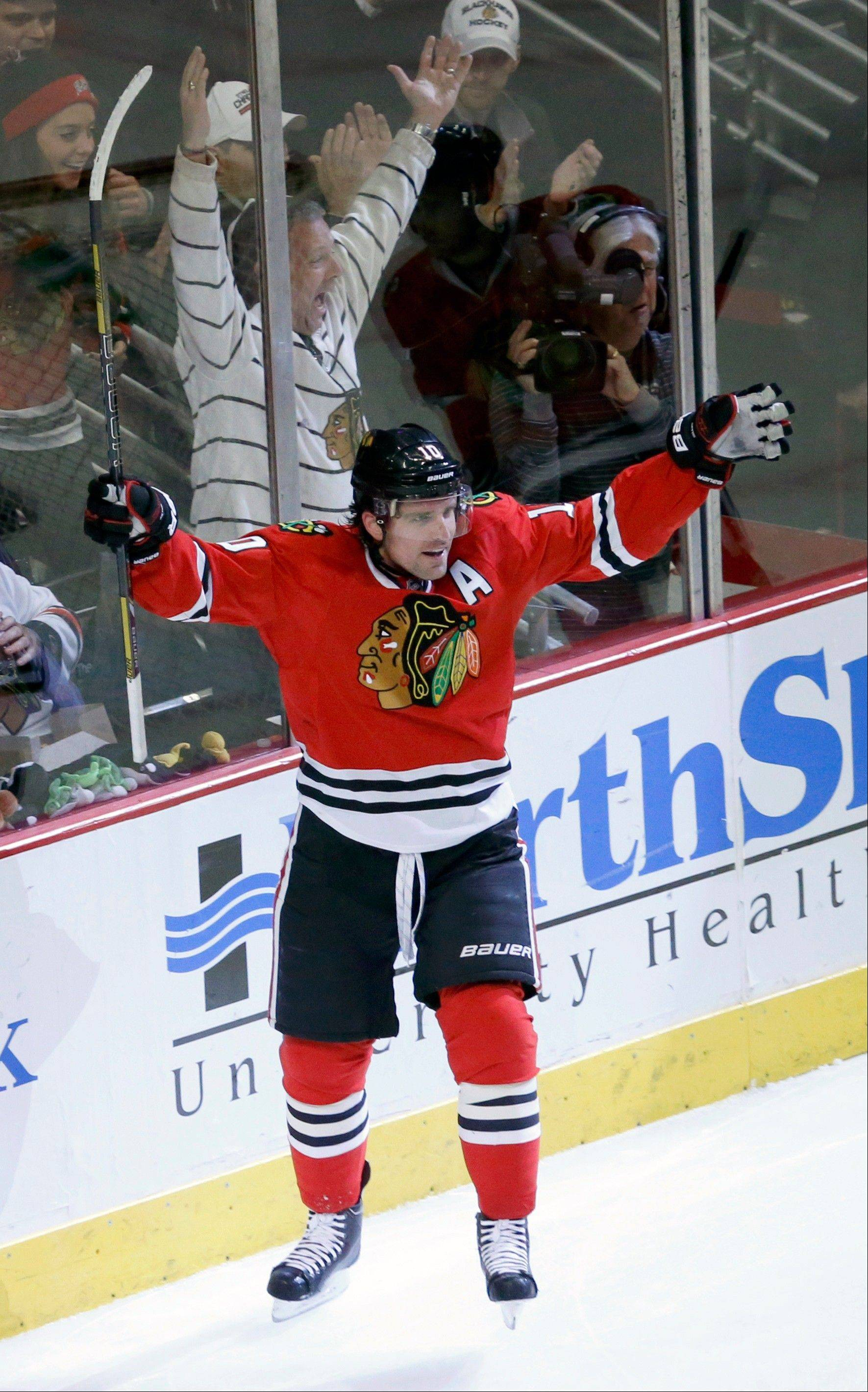 Blackhawks left wing Patrick Sharp celebrates his goal during the first period of Friday's game against the Colorado Avalanche at the United Center.