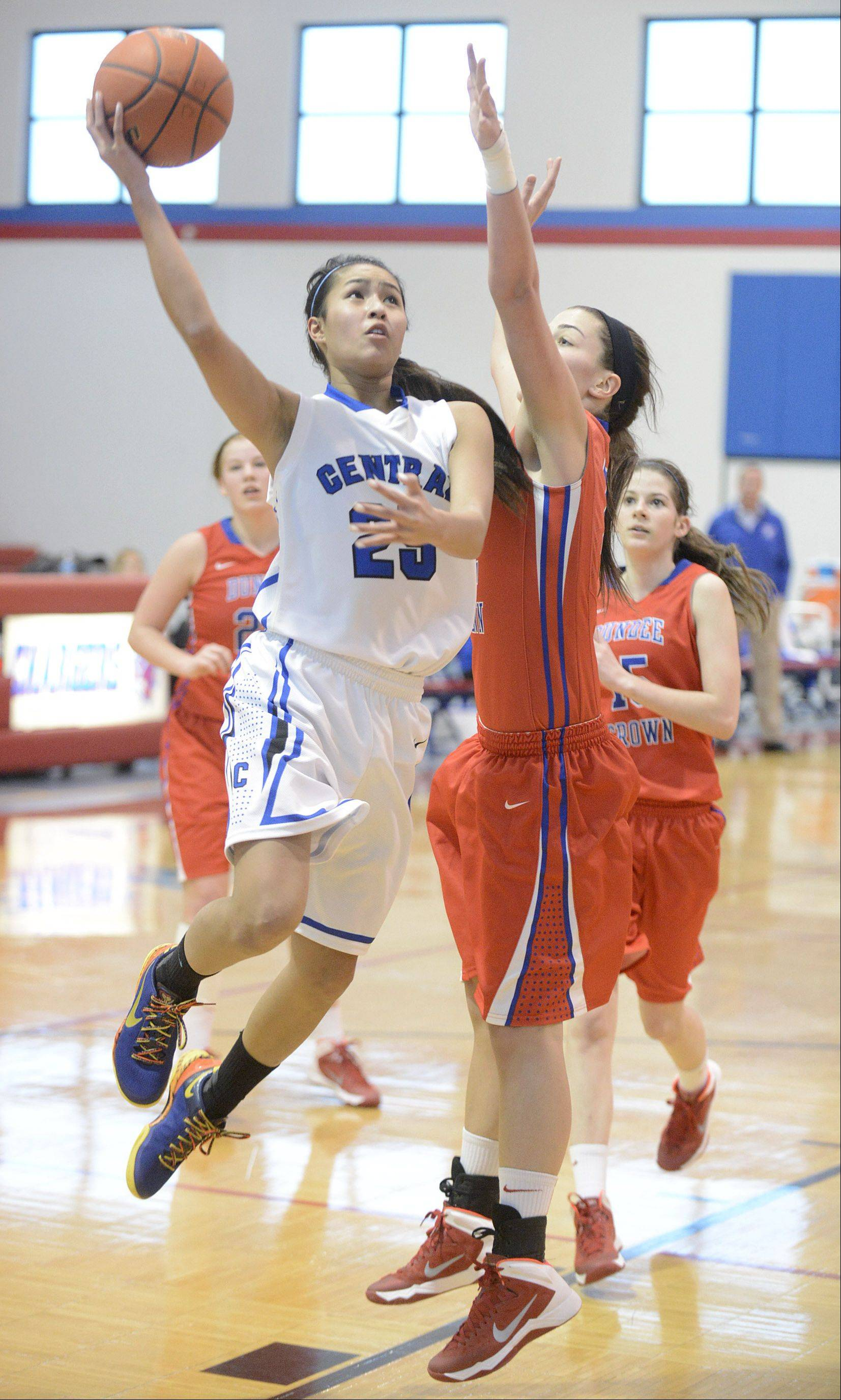 Burlington Central's Sam Cruz shoots over a block by Dundee-Crown's Lauren Lococo in the second quarter on Friday.