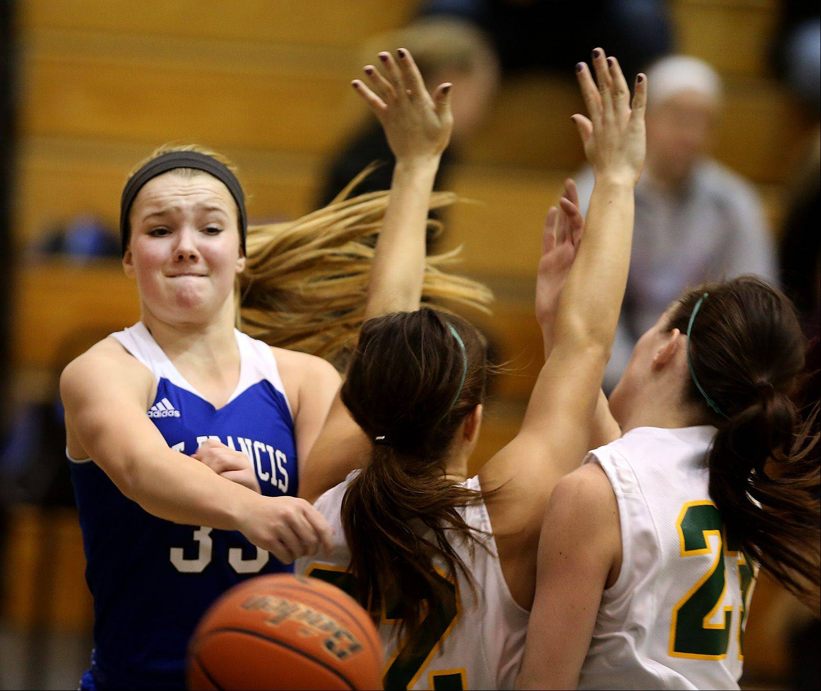 St. Francis� Carley Pasquale battles Coal City during the Lisle High School girls basketball Holiday Cage Classic.