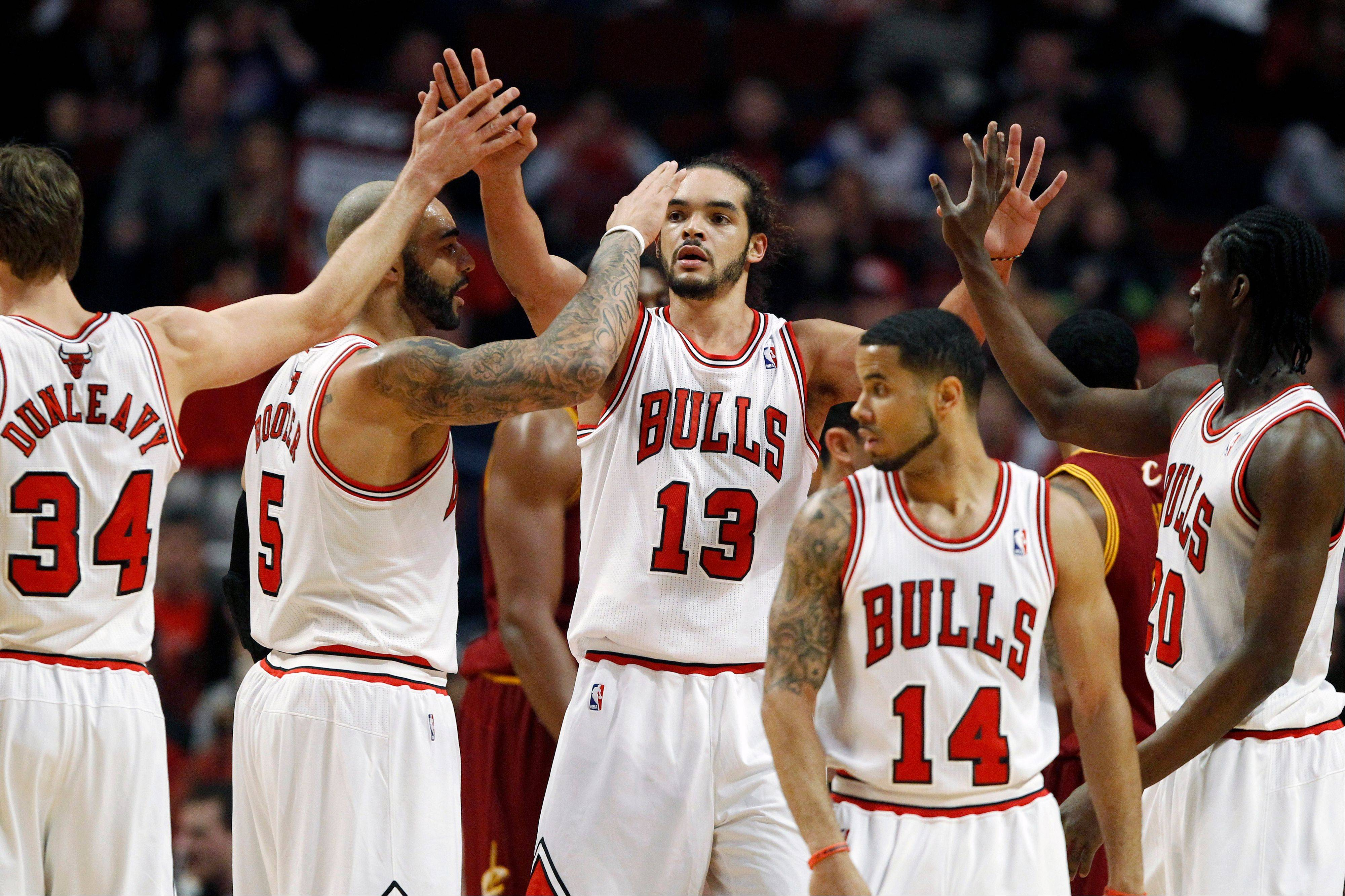 Noah misses Bulls practice, but Deng returns