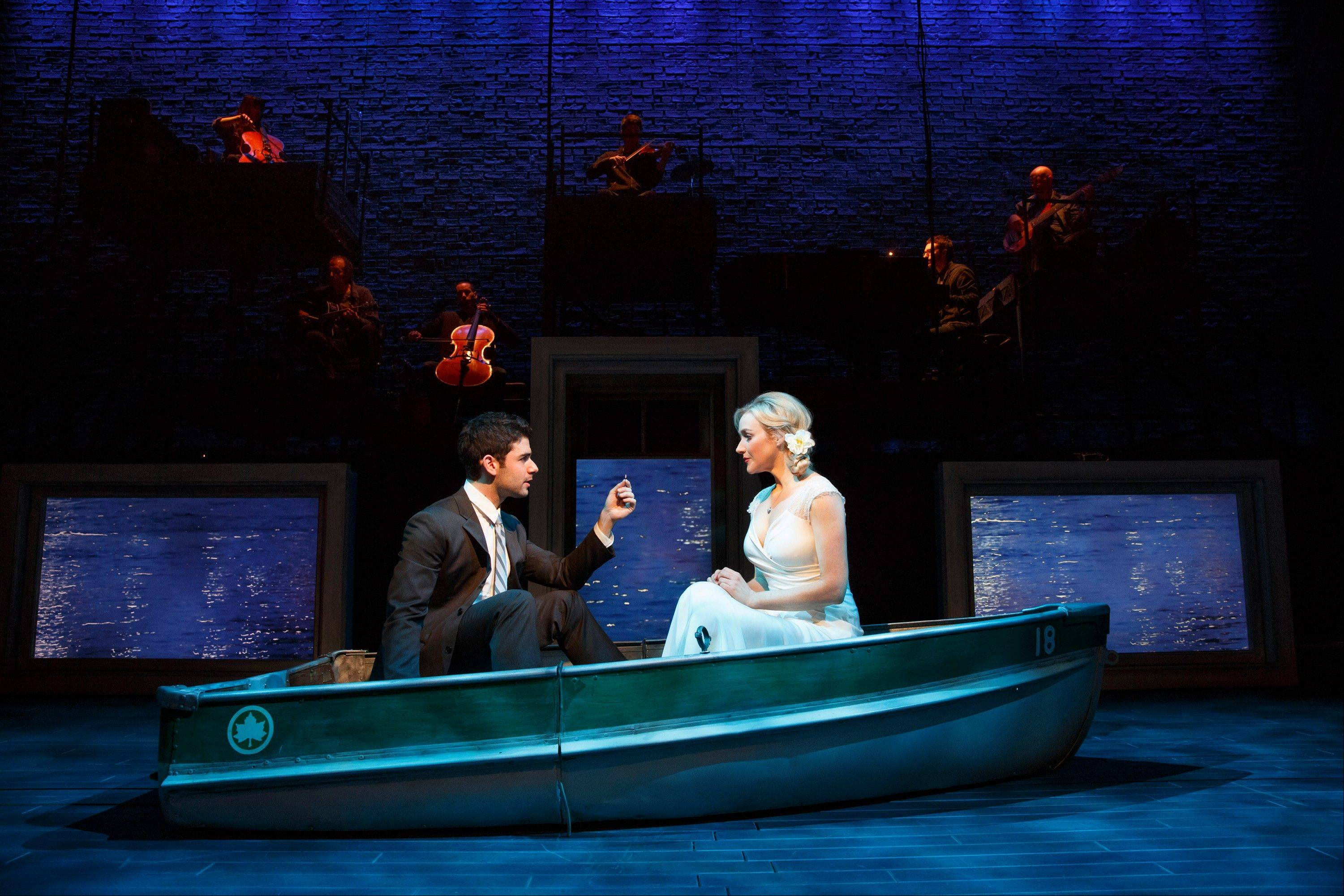 "This theater image released by The Hartman group shows Adam Kantor, left, and Betsy Wolfe during a performance of ""The Last Five Years,"" in New York. A revival of Jason Robert Brown's song cycle about a troubled marriage was a highlight of Second Stage Theatre's last season."