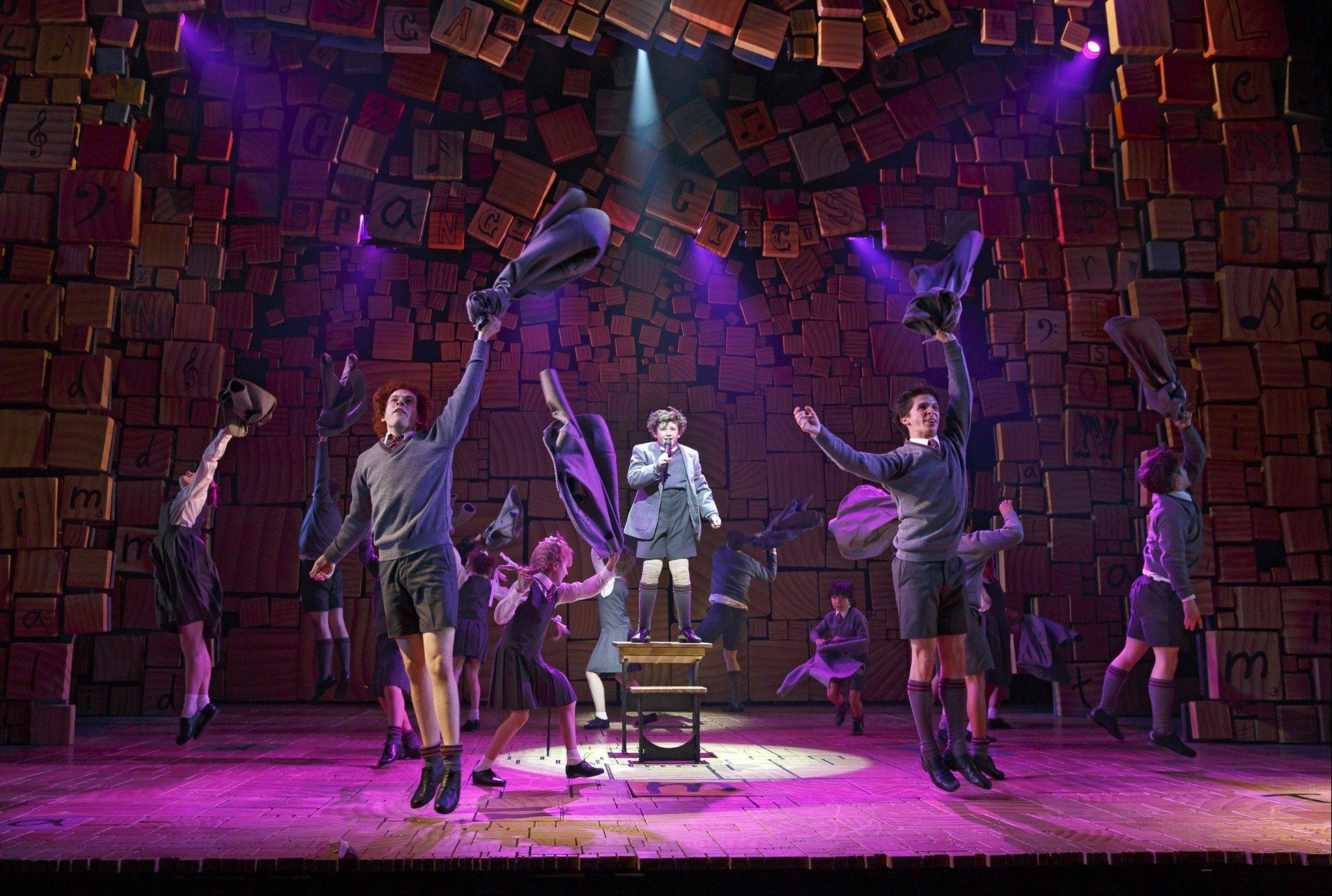 "This theater publicity image released by Boneau/Bryan-Brown shows the cast of ""Matilda The Musical,"" during a performance in New York. Great sets, choreography and songs make this British import hard to resist. Music and lyrics by Tim Minchin stick with you _ especially ""Miracle,"" ""Telly,"" ""When I Grow Up"" and ""The Smell of Rebellion"" _ and the whole show thrillingly reminds you of the darkness of being a kid."