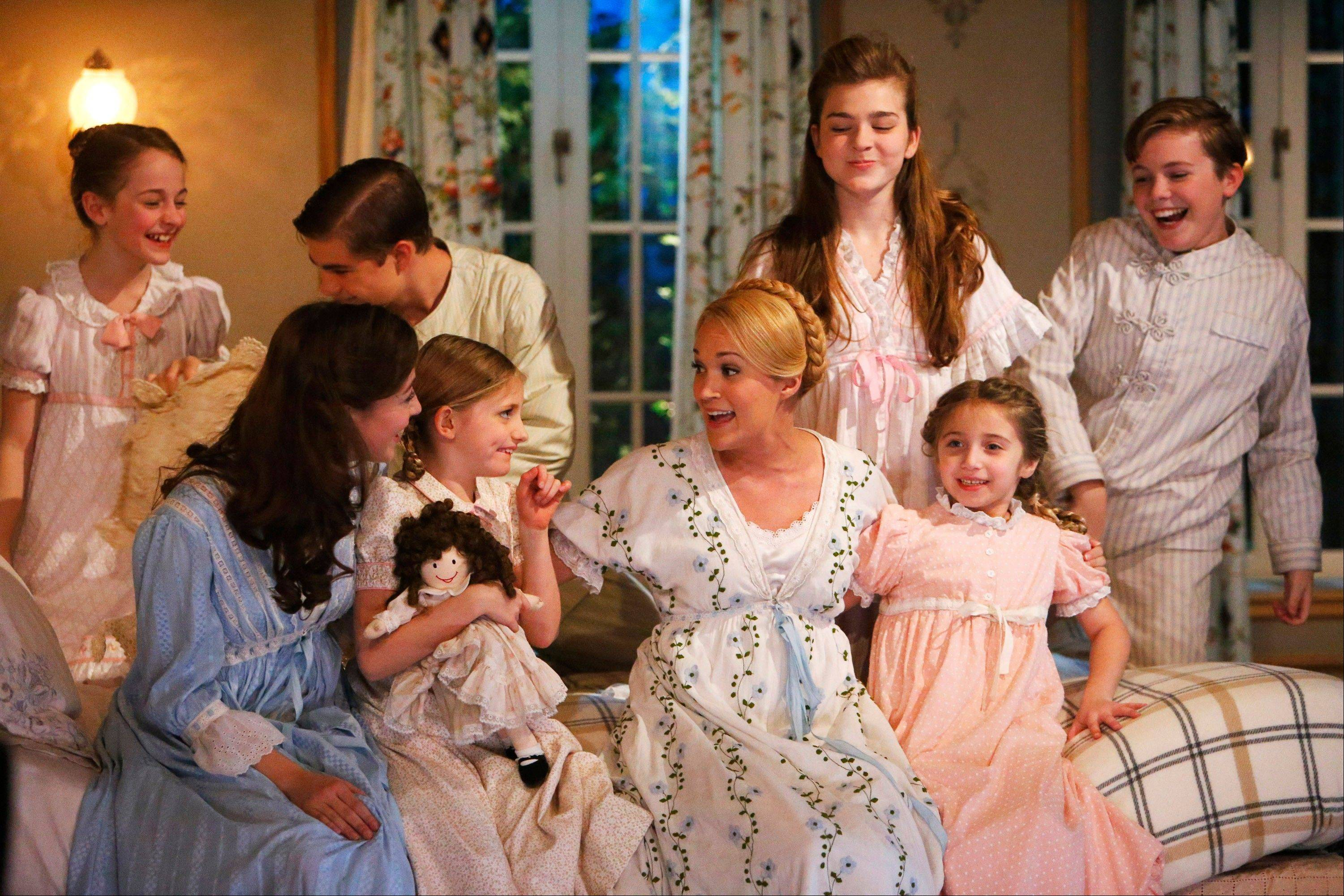 "This photo provided by NBC shows, from left, Sophia Ann Caruso as Brigitta, Ariane Rinehart as Liesl, Michael Nigro as Friedrich, Grace Rundhaug as Marta, Carrie Underwood as Maria, Ella Watts-Gorman as Louisa, Peyton Ella as Gretl, and Joe West as Kurt, in ""The Sound of Music Live!"" This Carrie Underwood-led show was on TV, but Broadway was in its DNA, from the supporting cast _ Christian Borle, Laura Benanti and Audra McDonald _ to co-director Rob Ashford. It was the first full-scale musical staged live for television in more than a half-century and drew an impressive 18.6 million viewers."