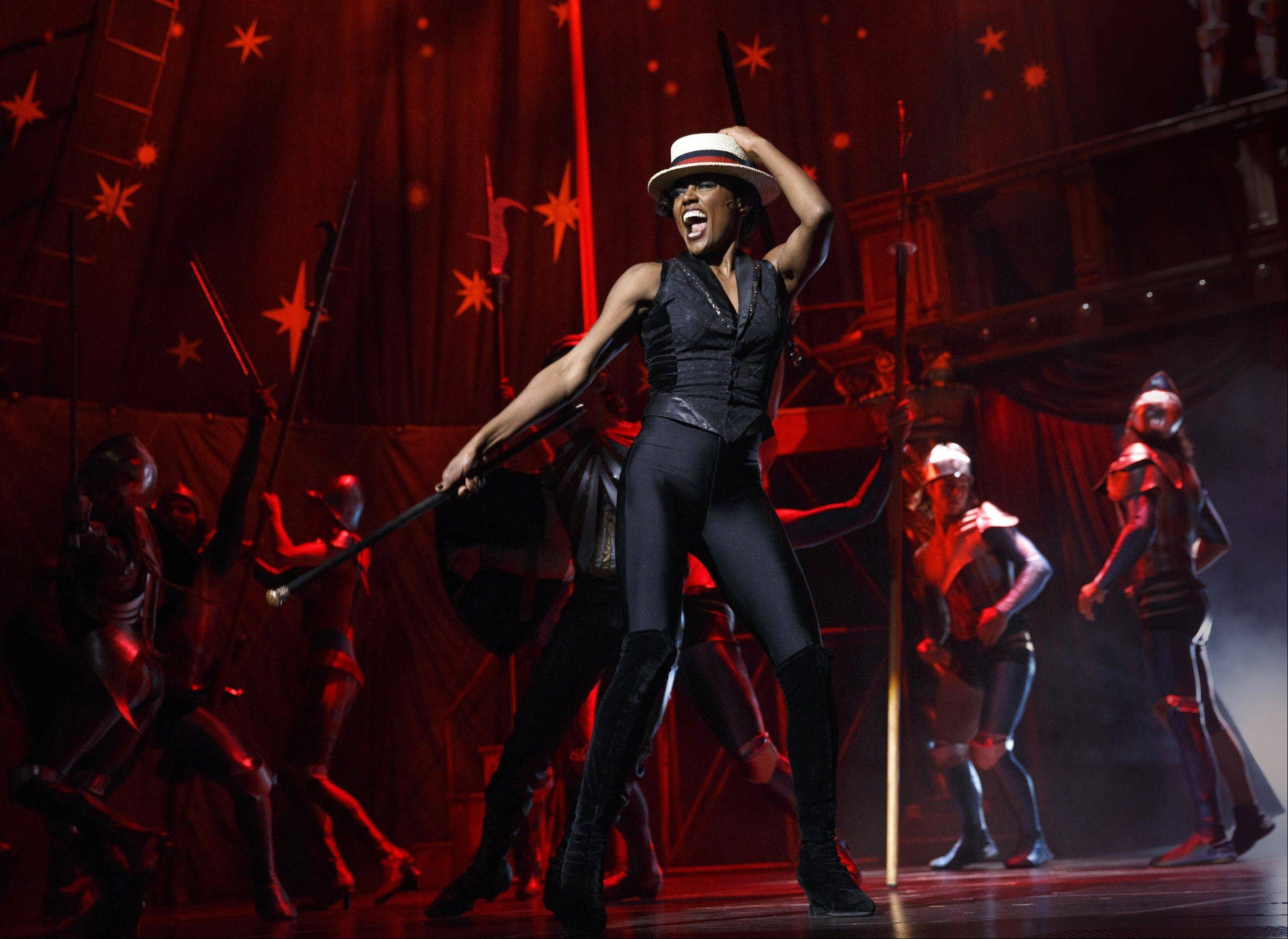 "This undated file image originally released by Boneau/Bryan-Brown shows Patina Miller during a performance of ""Pippin,"" at Broadway's Music Box Theatre in New York. The revival of the Stephen Schwartz musical led by director Diane Paulus packs plenty of bang, lots of flips and real value for money: A ticket buys you not just a musical but also a trip to the circus. There are fire jugglers, teeterboards, knife throwing and contortionists, as well as Bob Fosse-style dancing and great performances."