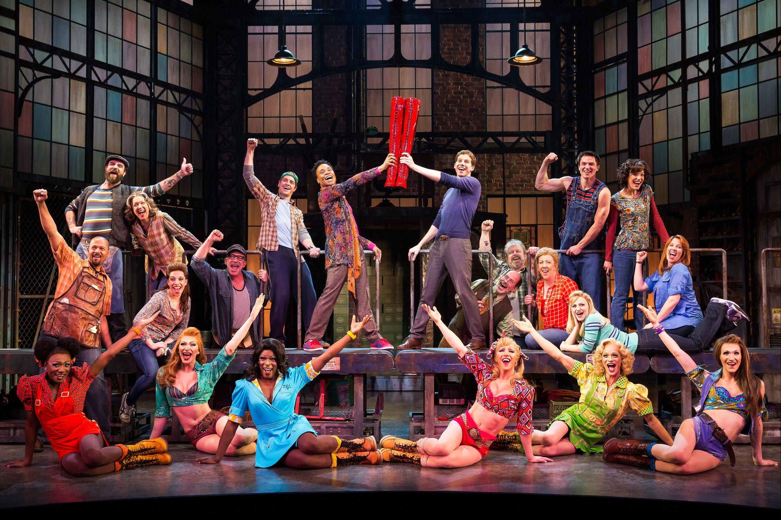 "This theater image released by The O+M Company shows the cast during a performance of the musical ""Kinky Boots."" The Tony Award musical winner with infectious songs by Cyndi Lauper and a sloppy kiss of a story by Harvey Fierstein is unabashedly sentimental, with a classic message of acceptance. Billy Porter, as the drag queen at its heart, can make tears fall down your cheeks and he's sticking with the show into 2014."