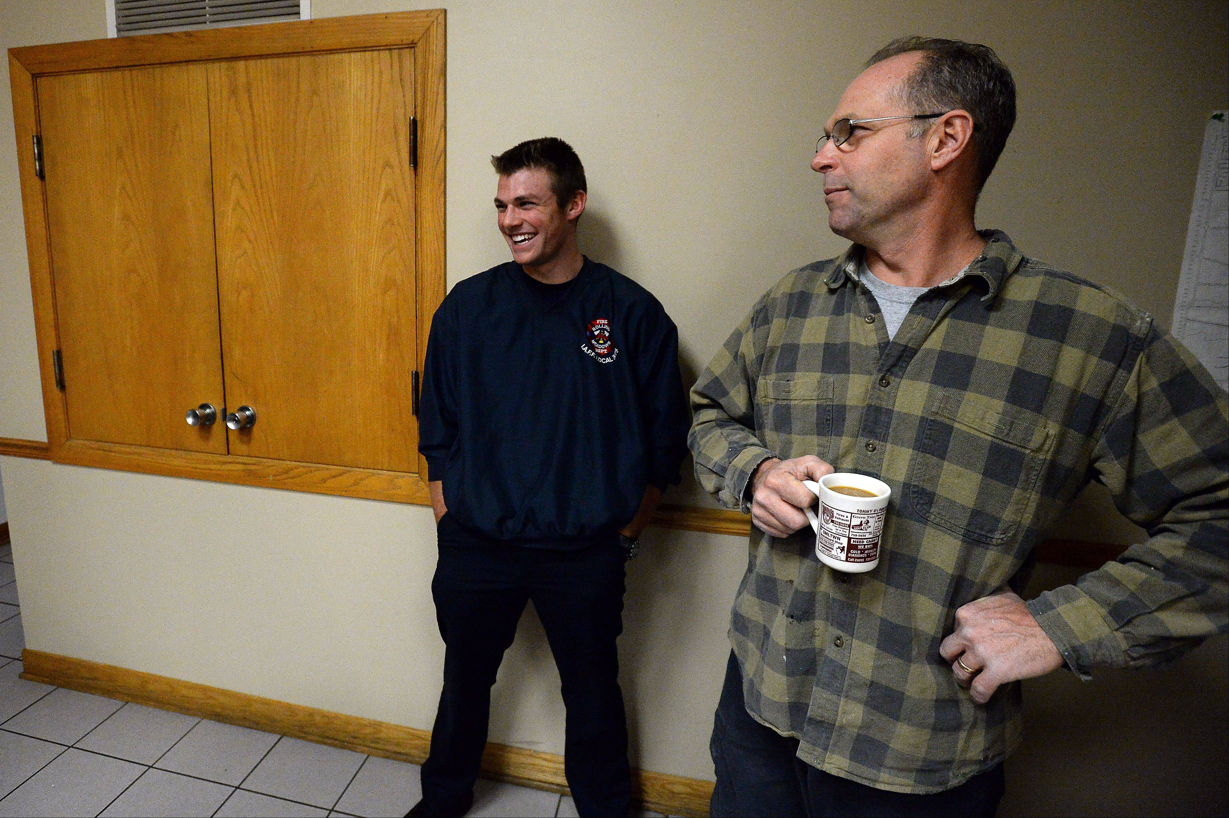 Rolling Meadows firefighter/paramedic John Loesch Jr. laughs as his father, John Loesch Sr., stops by the firehouse. Both are firefighter/paramedics and have worked together on the ambulance as a father and son paramedic team.