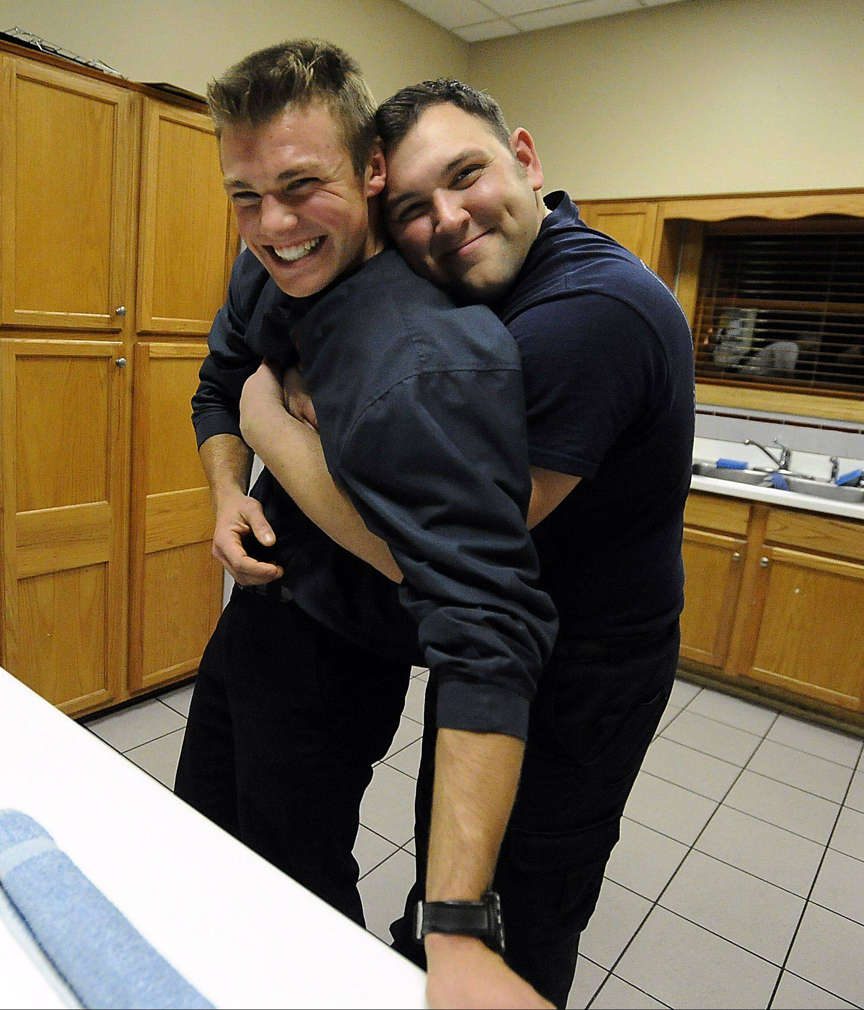 "Above, Loesch and his partner John Palmisano joke around before dinner. Loesch is a ""probie"" or probationary firefighter with only five months on the job and is targeted for practical jokes all the time."