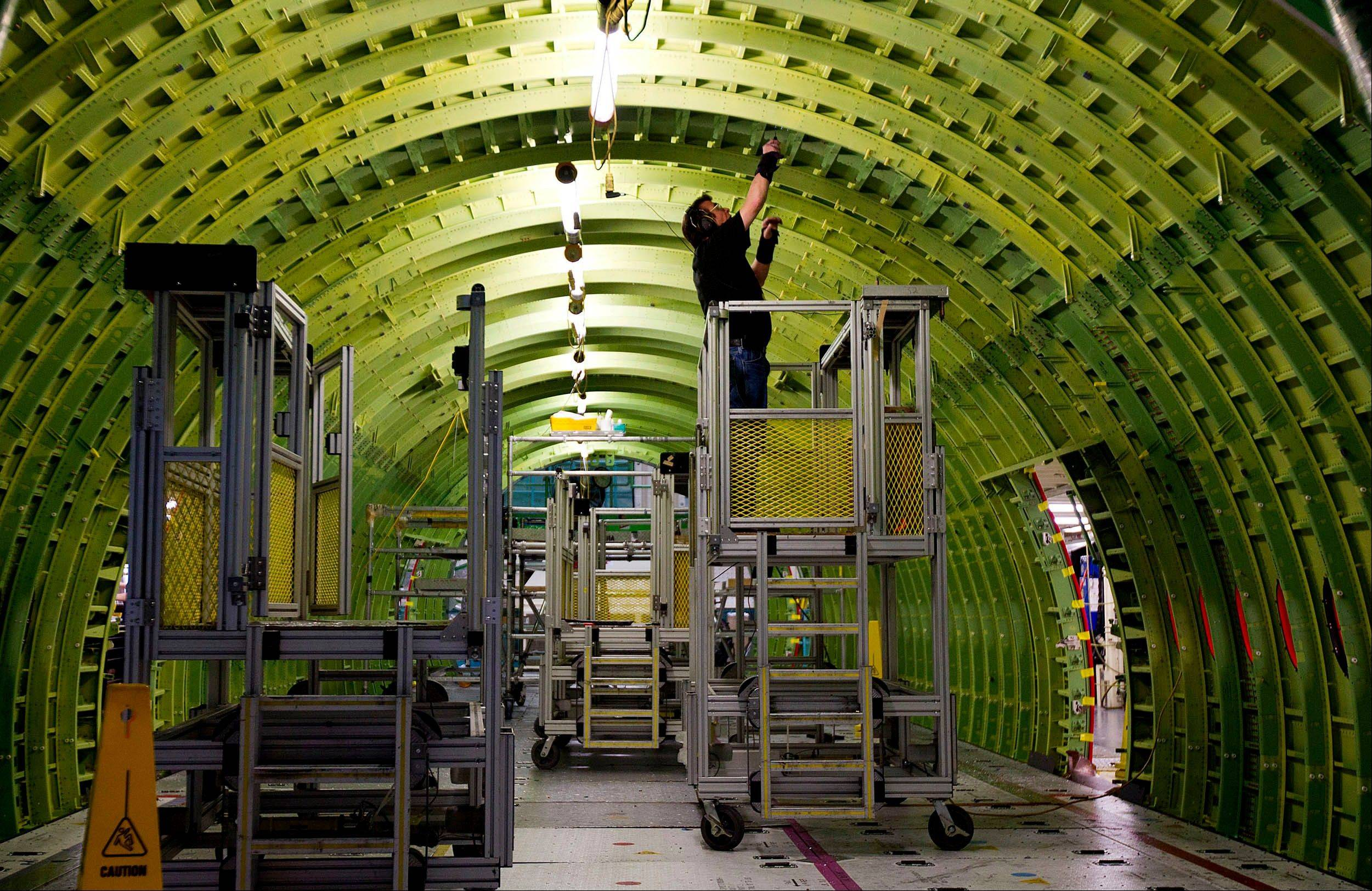A worker assembles a Boeing Co. 777 airplane last May at the company's production facility in Everett, Washington.