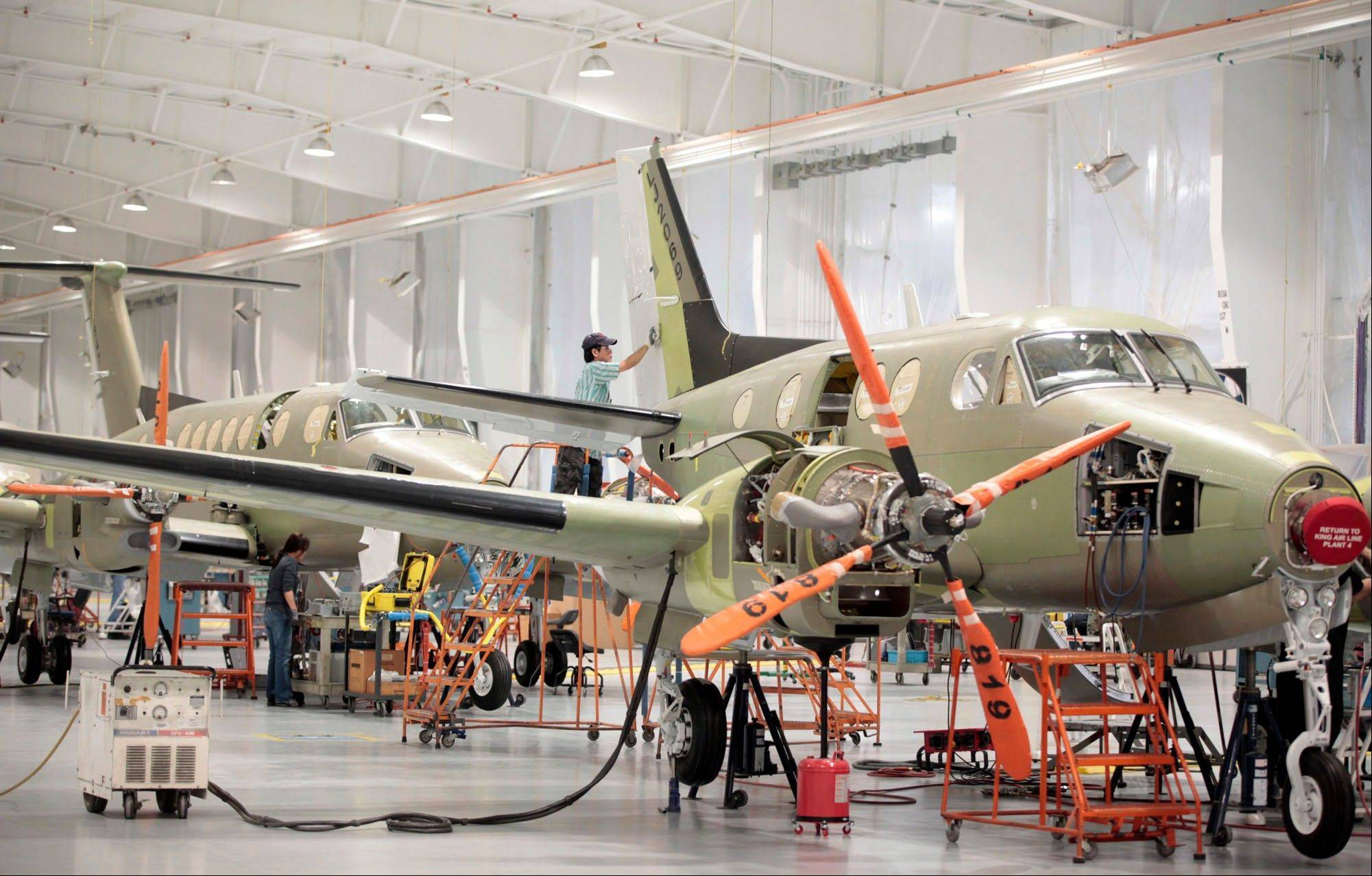 Aircraft move down the assembly line at Beechcraft in Wichita, Kan. Textron Inc., the parent company of Cessna Aircraft, announced Thursday, that it has reached an agreement to buy Beechcraft Corp. for approximately $1.4 billion.