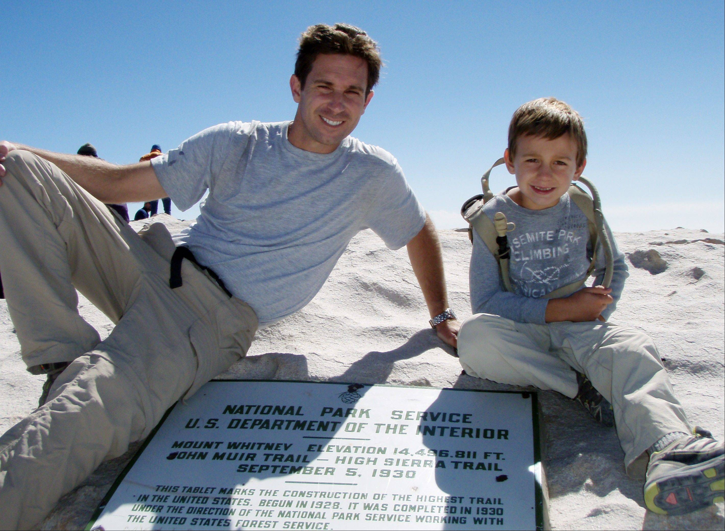 Kevin and his son, Tyler Armstrong, 7, after reaching the summit of Mount Whitney in the Sierra Nevada, Calif. On Christmas of this year Tyler, now 9, became the youngest person in recorded history to reach the summit of Argentinaís Aconcagua mountain.
