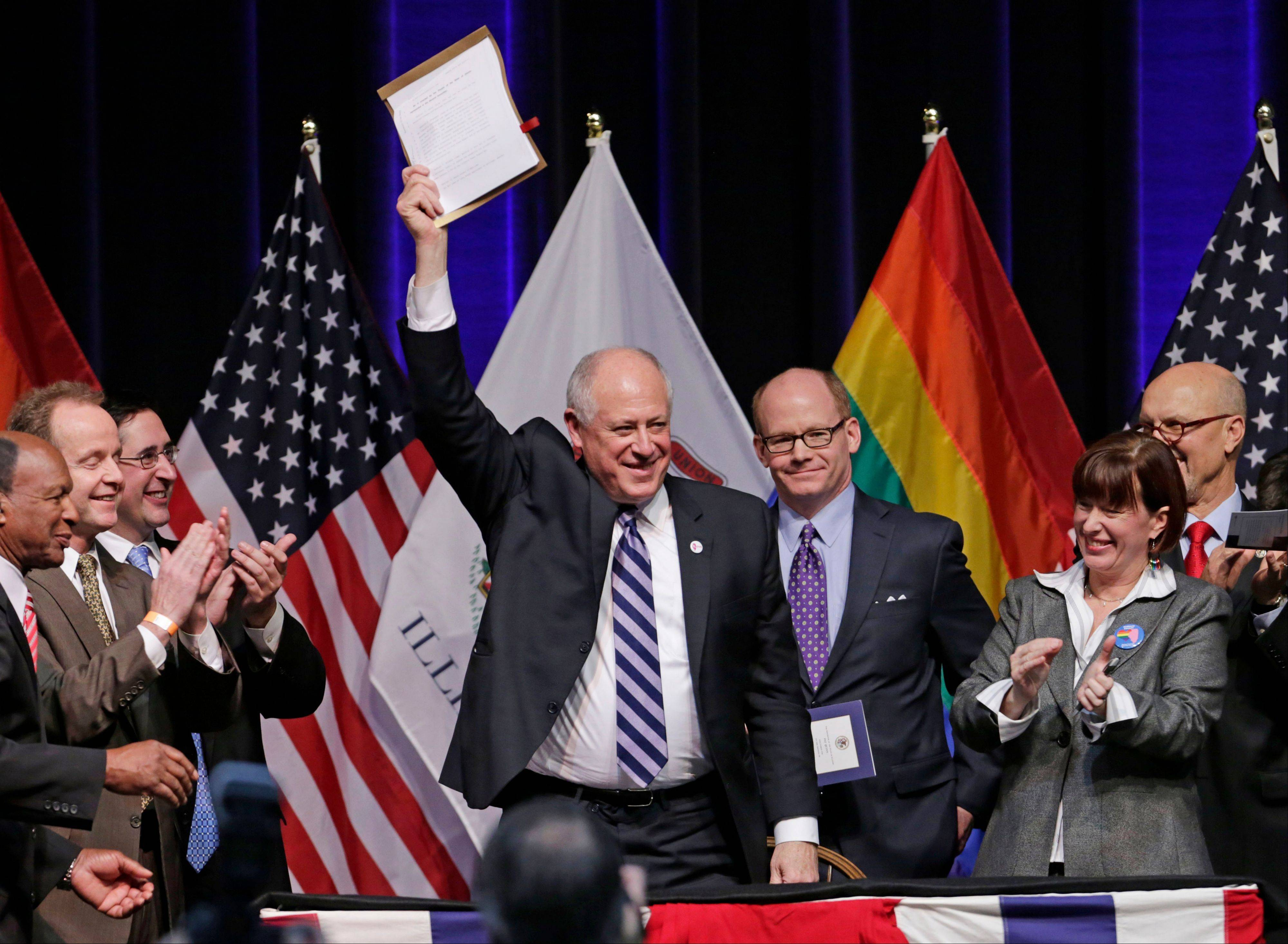 Illinois Gov. Pat Quinn acknowledges the applause after signing the Religious Freedom and Marriage Fairness Act into law, making Illinois the 16th state in the nation to embrace full marriage equality for same sex couples, Wednesday, Nov. 20, 2013, in Chicago. The law takes effect June 1, 2014.