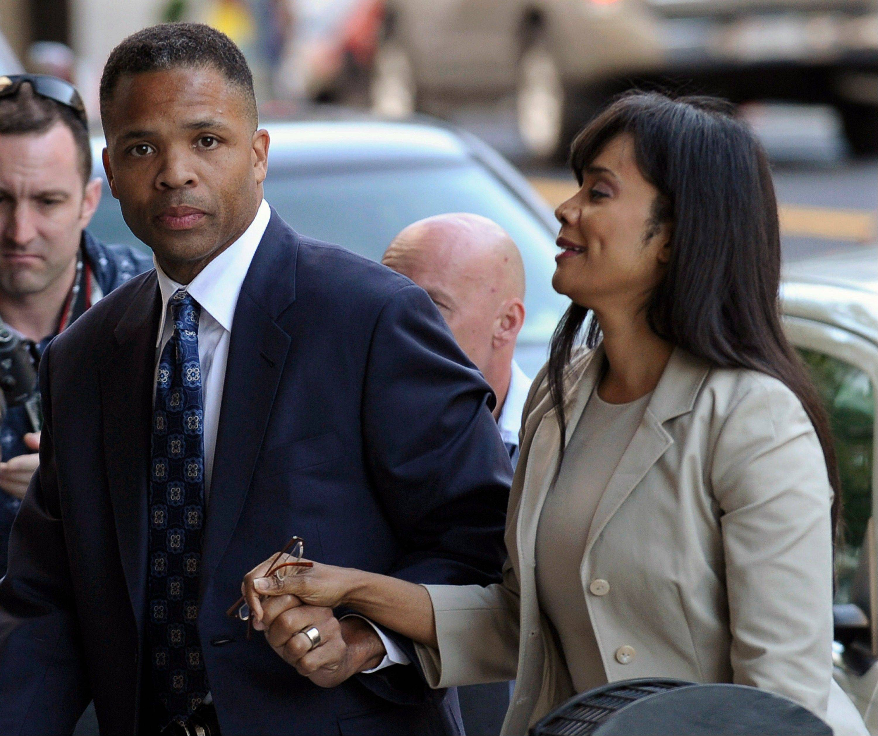 In this Aug. 14, 2013 file photo, former Illinois Rep. Jesse Jackson Jr. and his wife, Sandra, arrive at federal court in Washington to learn their fates when a federal judge sentences the one-time power couple for misusing $750,000 in campaign money on everything from a gold-plated Rolex watch and mink capes to vacations and mounted elk heads. The story was voted as one of the top 10 stories in Illinois for 2013.