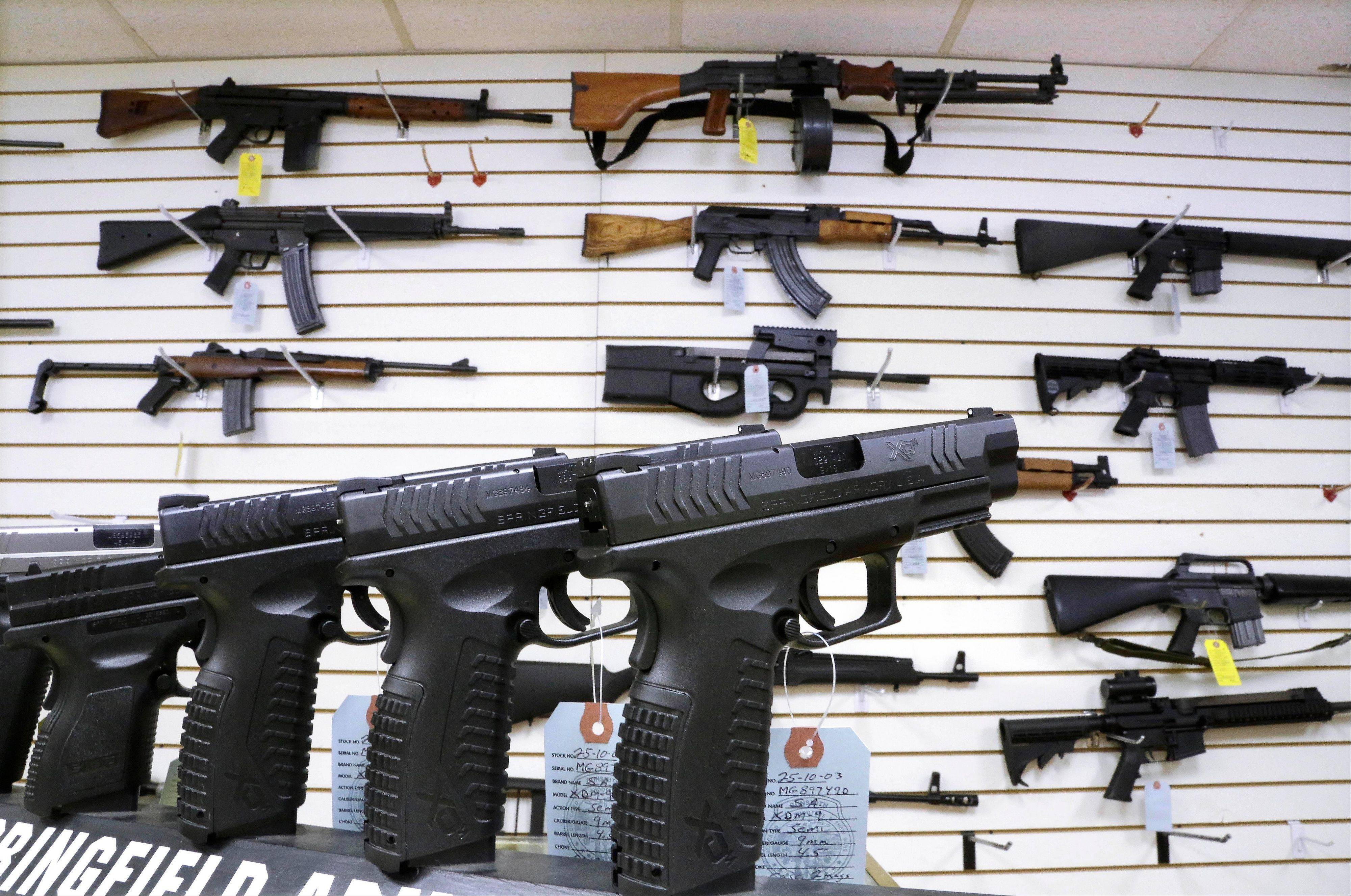In this Jan. 16, 2013 file photo, assault weapons and hand guns are seen for sale at Capitol City Arms Supply in Springfield, Ill. Illinois became the last state in the nation to allow the concealed carry of firearms after a federal court ruling and lengthy negotiations in the General Assembly. The story was voted as one of the top 10 stories in Illinois for 2013.