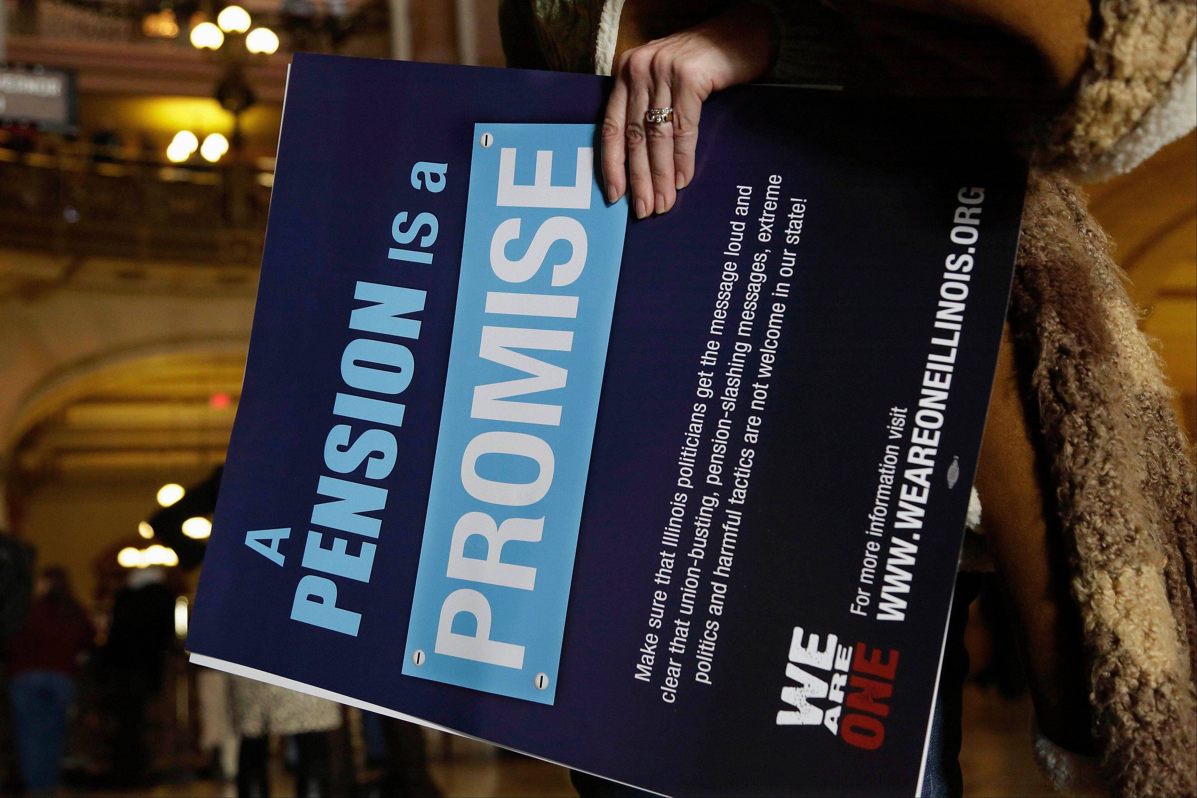 In this Jan. 3, 2013 file photo, a sign is carried during a rally by Illinois state union members and supporters in support for fair pension reform at the Illinois State Capitol in Springfield. In December Gov. Pat Quinn signed the pension overhaul legislation bill in Chicago. The passing of the landmark $160 billion legislation was voted the top story in Illinois for 2013.