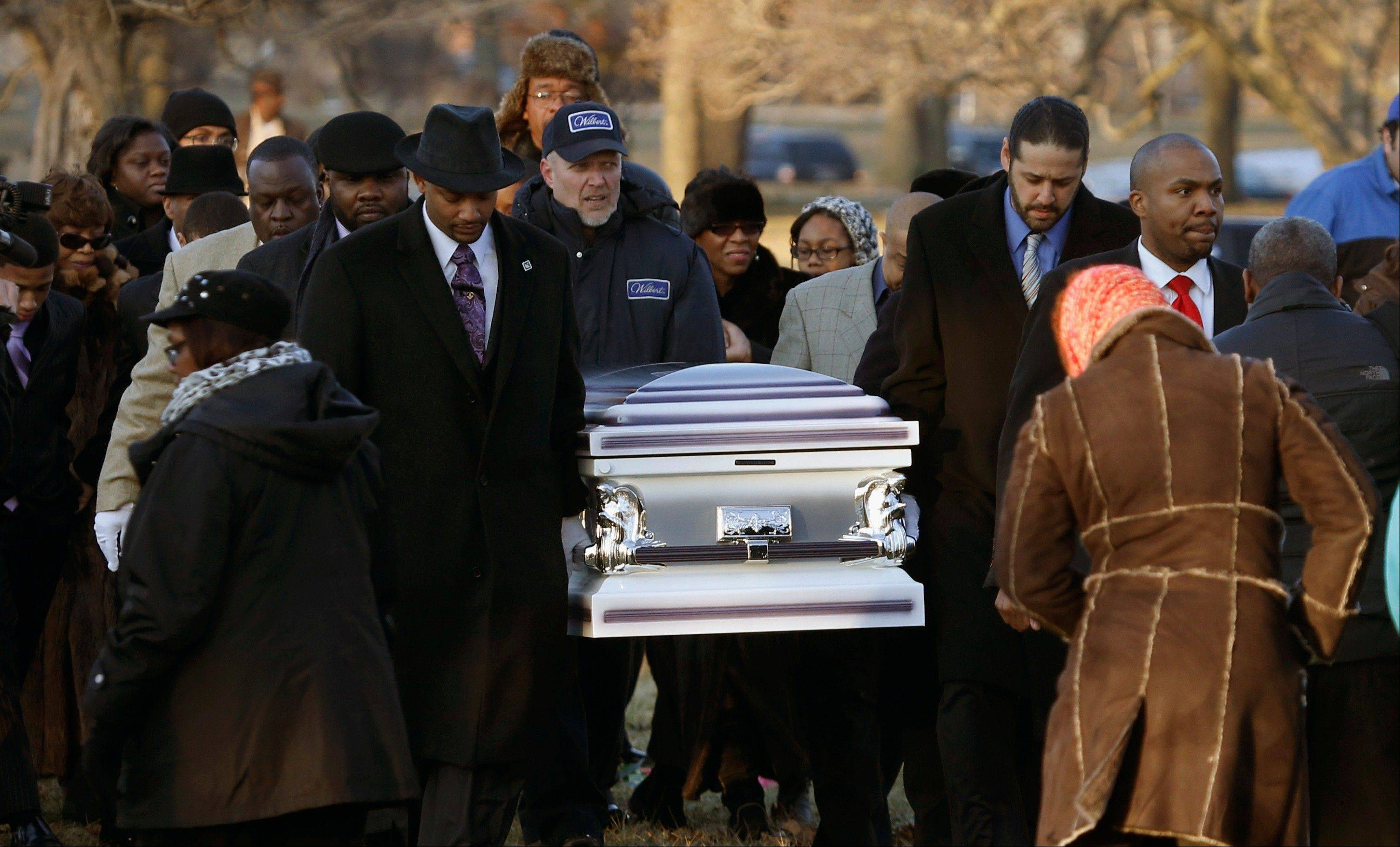 In this Feb. 9, 2013 file photo, the remains of 15-year-old Hadiya Pendleton are taken to her final resting place at the Cedar Park Cemetery in Calumet Park, Ill. Pendleton was killed on Jan. 29, when a gunman opened fire on her and some friends seeking shelter in a park from the rain about a mile from President Obama's Chicago home. first lady Michelle Obama attended the funeral with Senior White House Adviser Valerie Jarrett and Secretary of Education Arne Duncan. Chicago's continuing battle against gang violence was voted as one of the top 10 stories in Illinois for 2013.