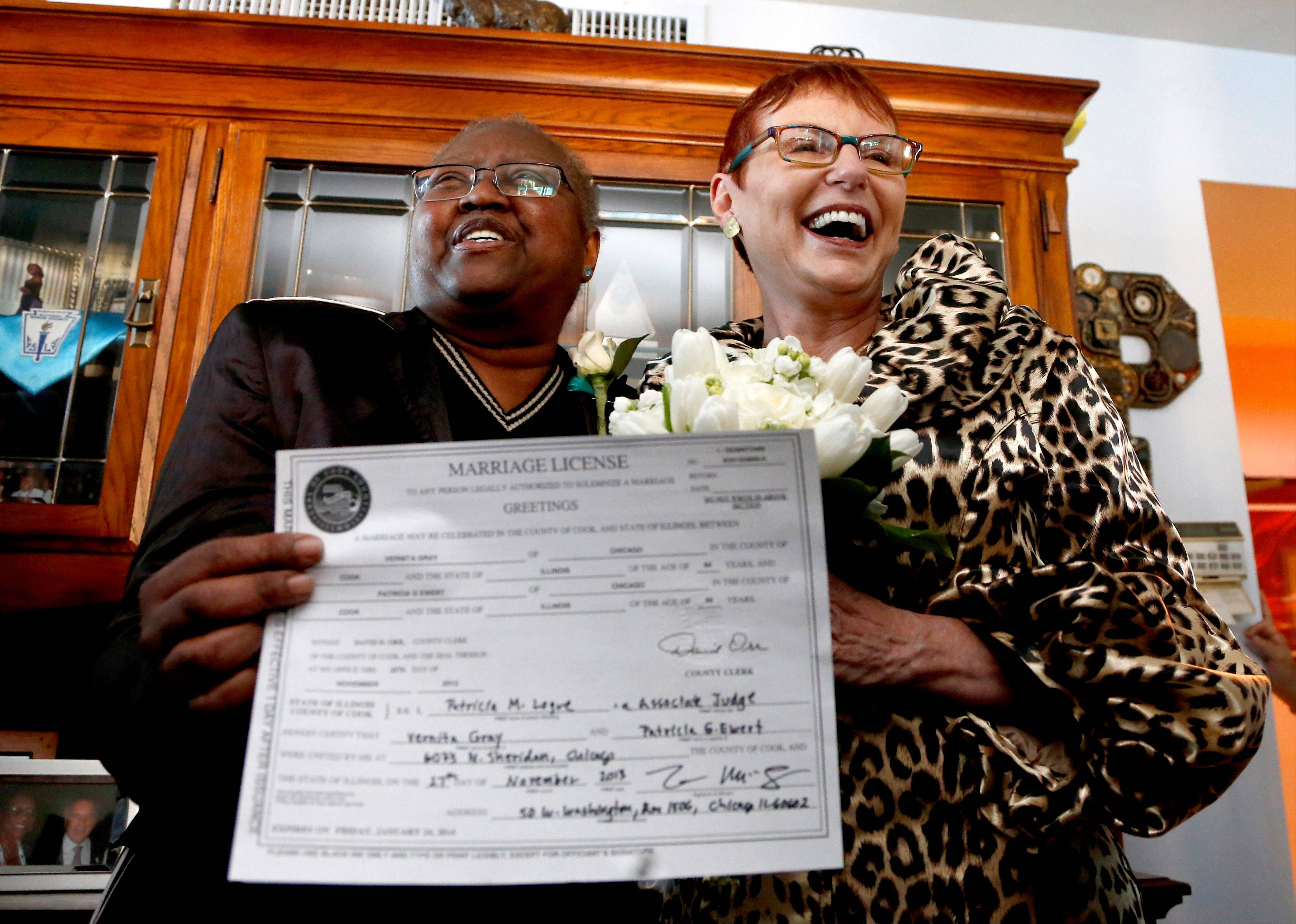 In this Nov. 27, 2013 file photo, Vernita Gray, left, and Patricia Ewert smile at friends after they were married in Chicago by Cook County Judge Patricia Logue, the first gay marriage in Illinois. A judge ordered the Cook County clerk to issue an expedited marriage license to Gray and Ewert before the state's gay marriage law takes effect in June 2014, because Gray is terminally ill. The story on the Illinois General Assembly approving the gay-marriage bill was voted as one of the top 10 stories in the state for 2013.