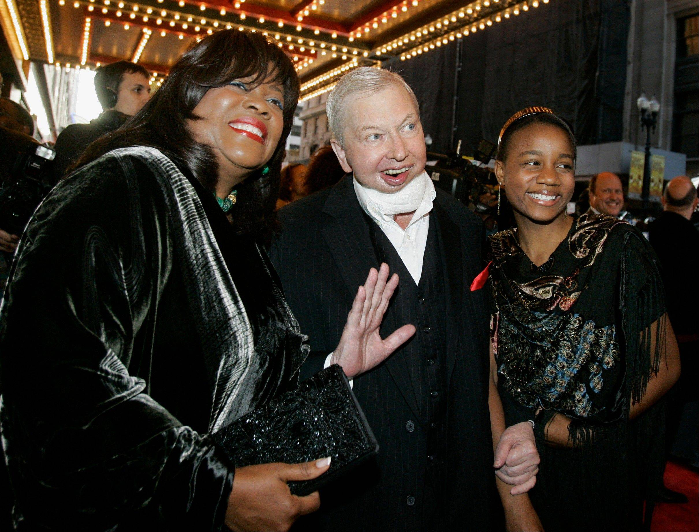 "In this May 3, 2007 file photo, film critic Roger Ebert, center, his wife Chaz, left, and their granddaughter Raven Evans, right, arrive for the Chicago premiere of the Broadway hit ""The Color Purple."" Ebert's death in April 2013 was voted as one of the top 10 stories in Illinois for 2013."