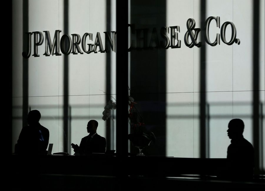 The JPMorgan Chase & Co. logo is displayed at their headquarters in New York, Monday, Oct. 21, 2013. In November 2013, JPMorgan, the biggest U.S. bank, agreed to pay $13 billion in a civil settlement with the Justice Department and state regulators over its sales of risky mortgage securities. It was the largest settlement ever between the Justice Department and a corporation.