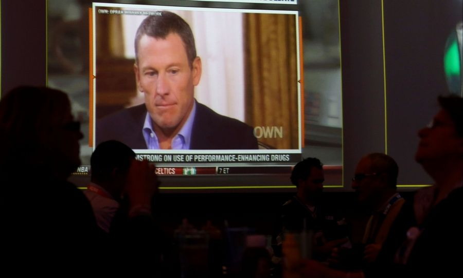 A video screen at a hotel restaurant in Grapevine, Texas on Friday, Jan. 18, 2013 shows a replay telecast of Lance Armstrong being interviewed by Oprah Winfrey, Reversing more than a decade of denials, Armstrong confessed to using performance-enhancing drugs to win the Tour de France cycling during the interview that aired night before.