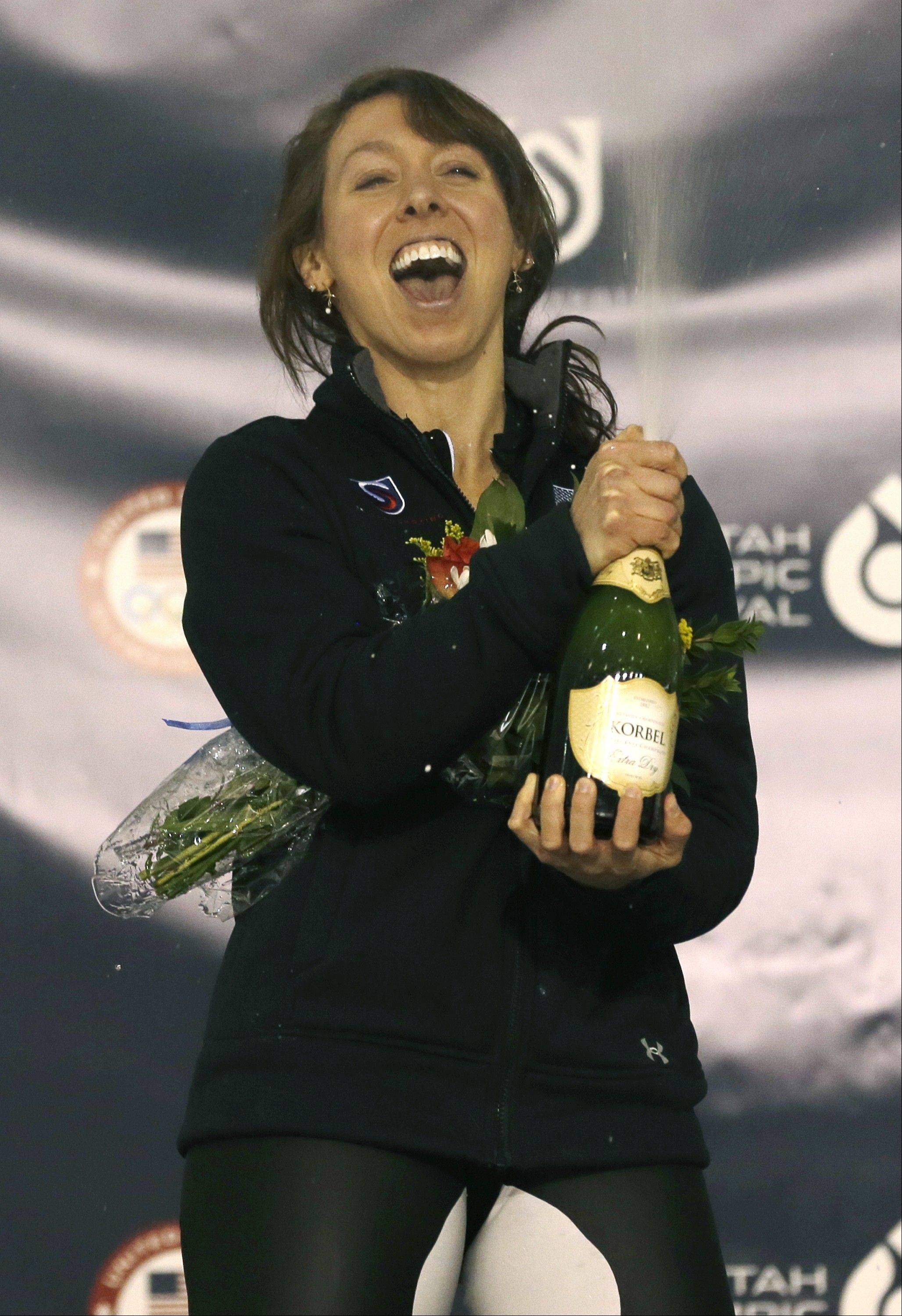 Jilleanne Rookard celebrates on the medals podium after winning the women's 3,000-meter race during the U.S. Olympic speedskating trials on Friday in Kearns, Utah.