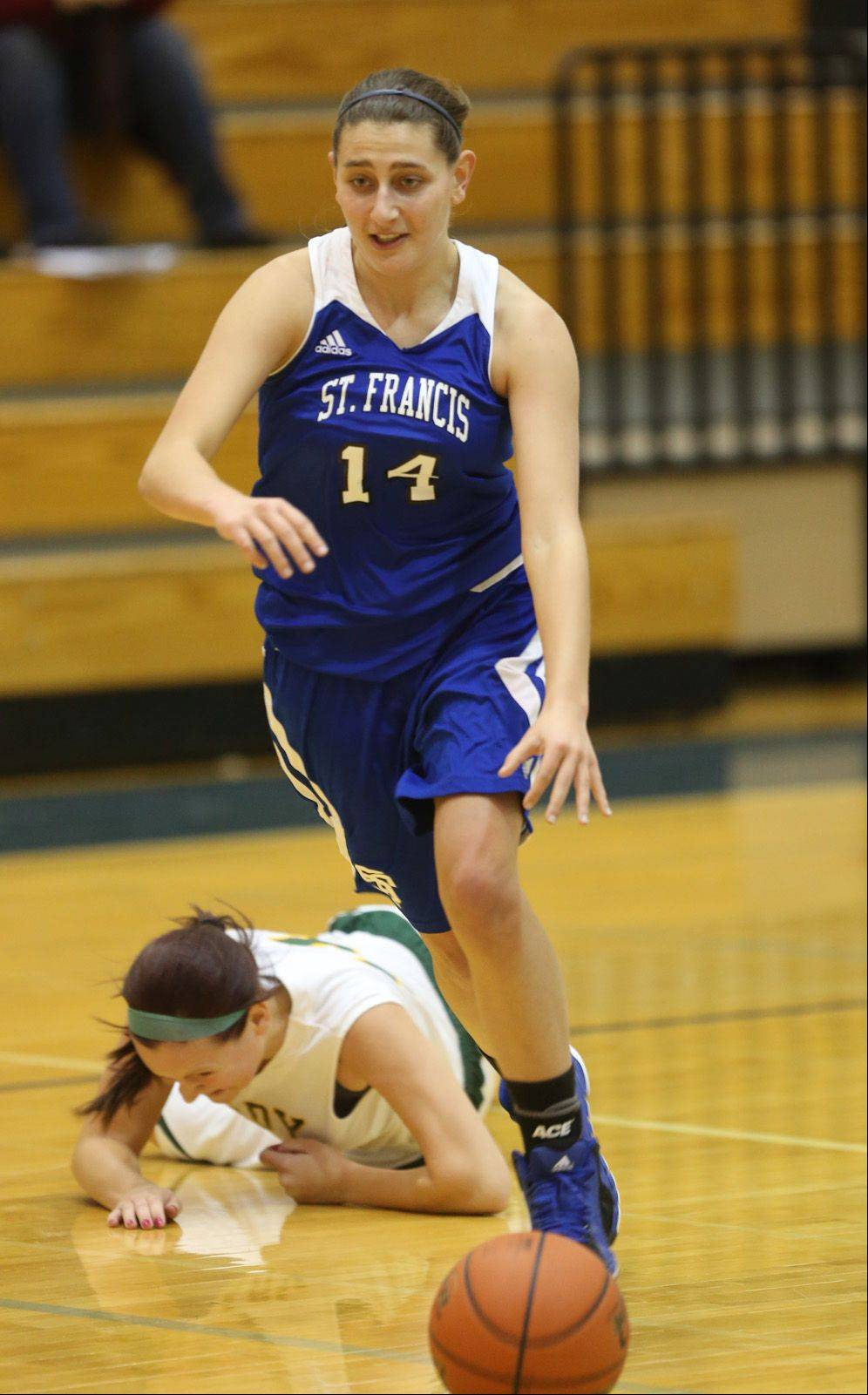 St. Francis' Reagan Kasprak moves up court against Coal City during the Lisle High School girls basketball Holiday Cage Classic.