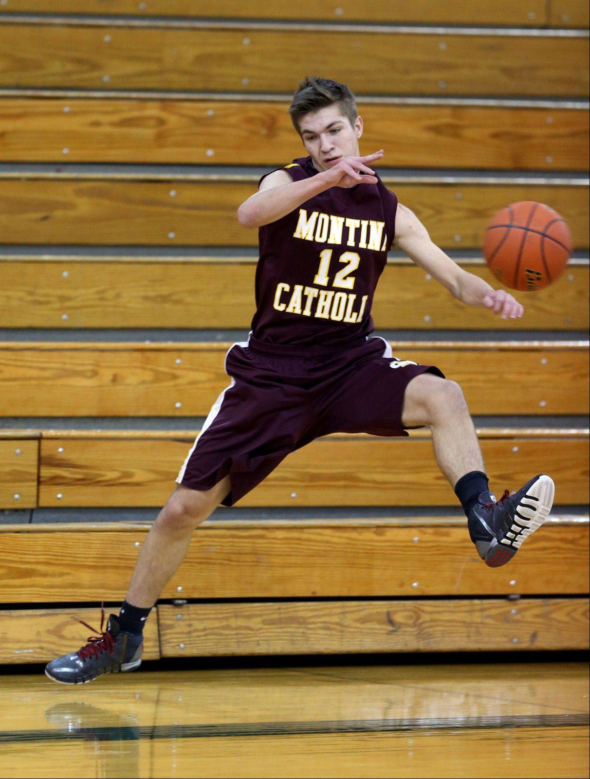 Montini's David Alden looks to pass the ball back inbounds against Fenton during the 12th annual Glenbard West Holiday Classic boys basketball tournament.