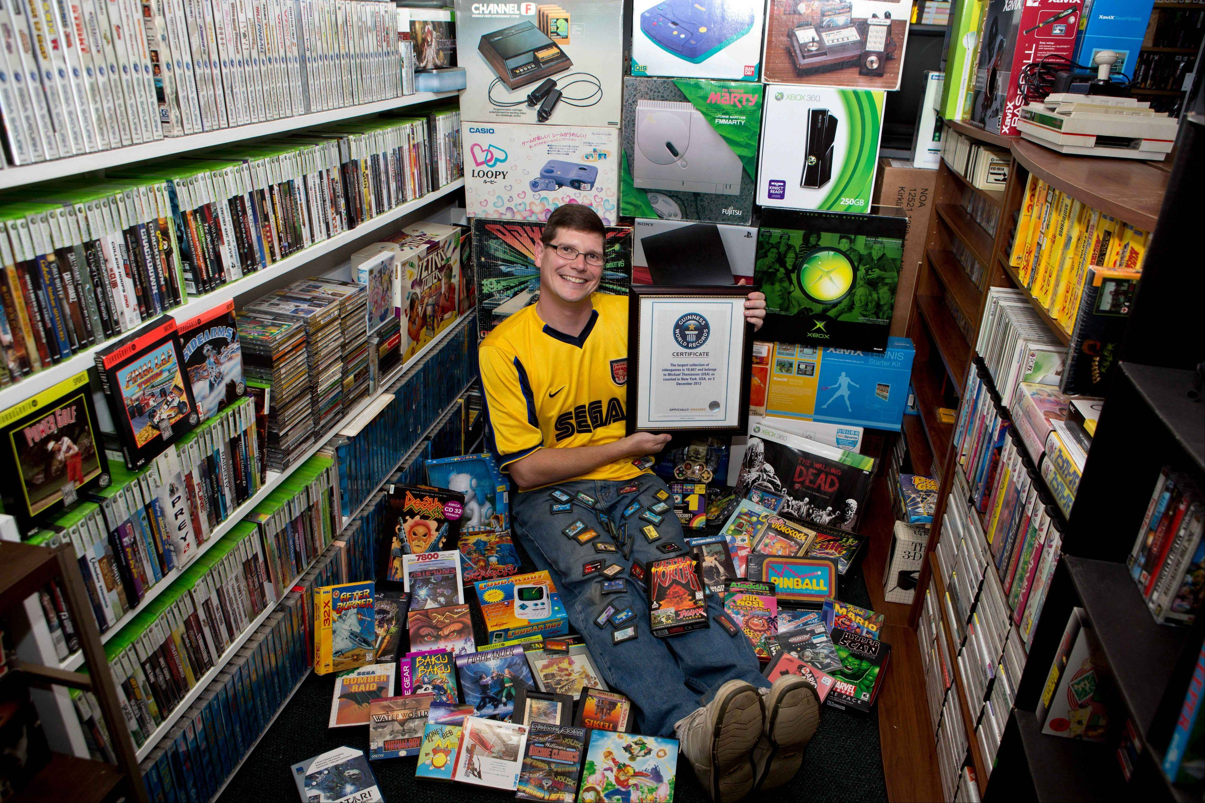 Michael Thomasson is featured in the just-released �Guinness World Records 2014 Gamer�s Edition,� for having the largest collection of video games, 10,607. The number bests the previous record holder, Richard Lecce of Florida, who had 8,616 games in 2010.