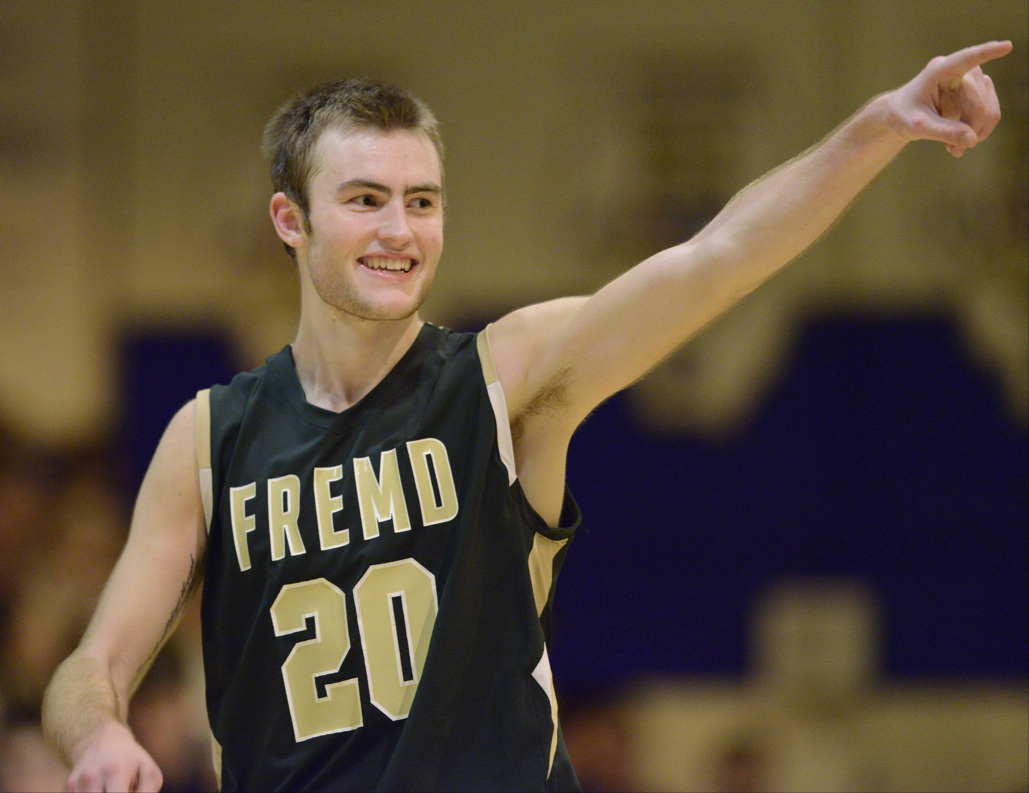 Fremd�s Riley Glassmann celebrates after his team topped St. Viator 77-67 to win the Wheeling Hardwood Classic on Saturday night.