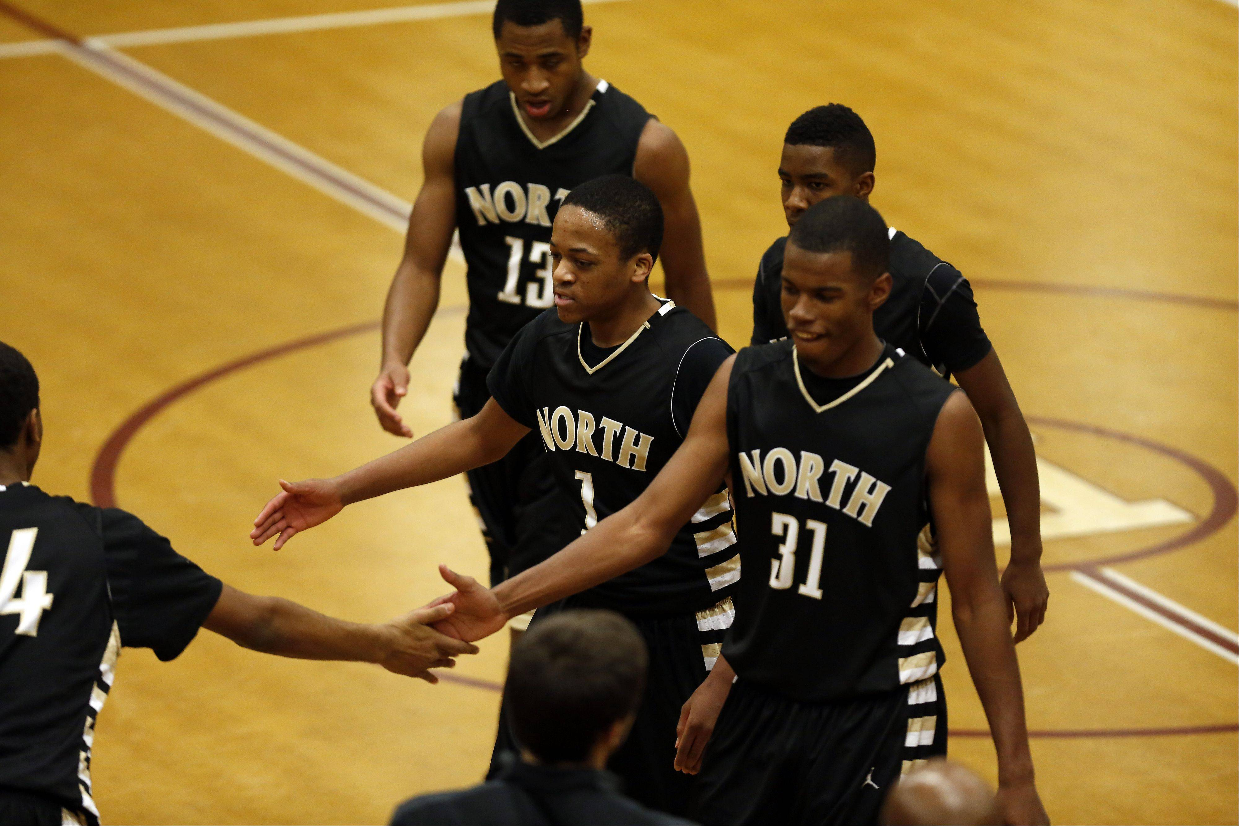 Glenbard North�s Jeremiah Fleming, center, and Chip Flanigan, right, leave the court at the end of the third quarter against Elgin at the 39th Annual Elgin Boys Holiday Basketball Tournament at Elgin High School Saturday December 28, 2013.