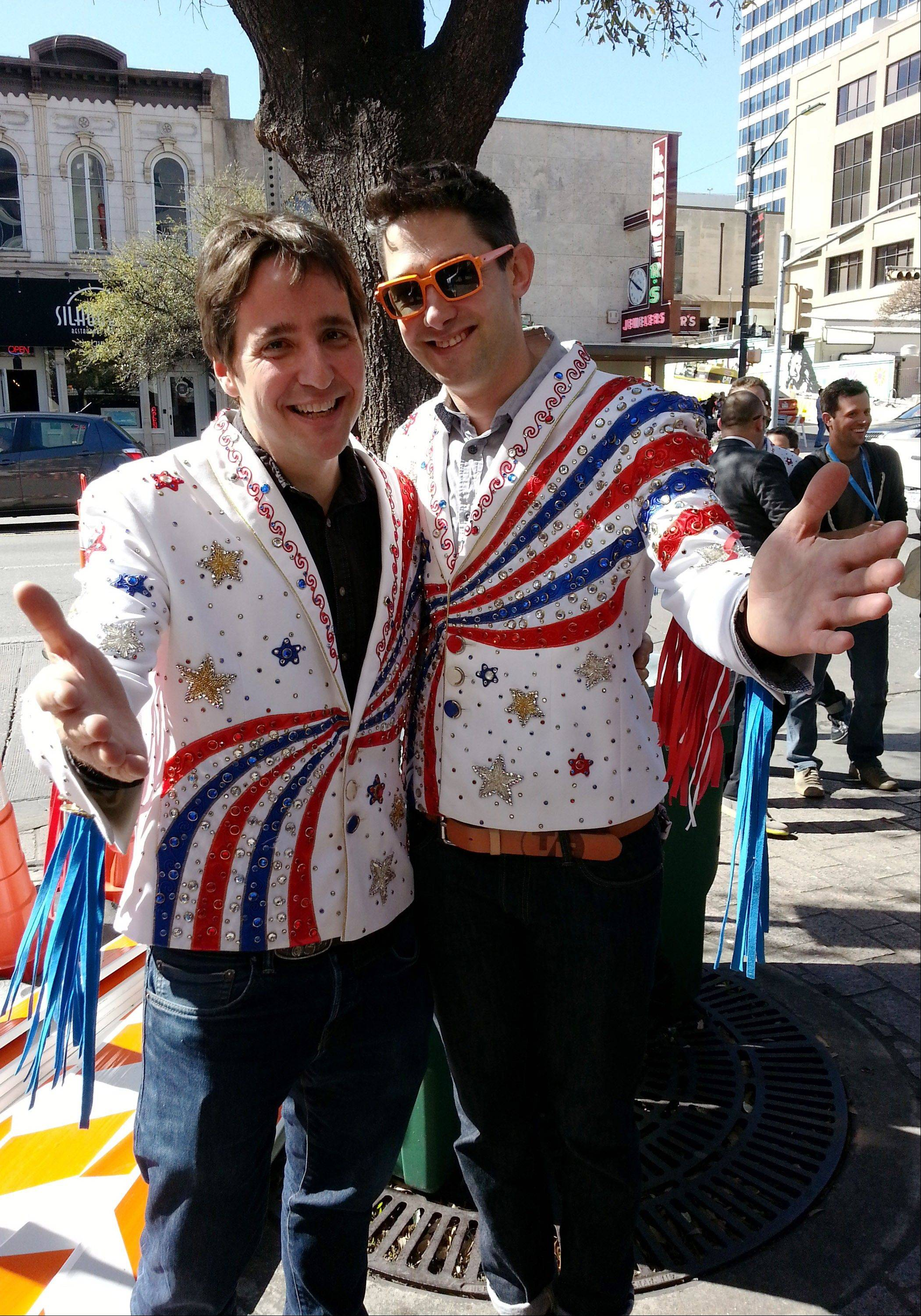 "AJ Schnack, left, and David Wilson, co-directors of the documentary film ""We Always Lie to Strangers,"" pose for a photo following the March premiere of the film at the South by Southwest Film Festival in Austin, Texas. Wilson and Schnack attended along with fellow collaborator Nathan Truesdell, all three wearing rhinestone-studded jackets similar to those worn by performers in one of the Branson, Mo., stage shows featured in the film."