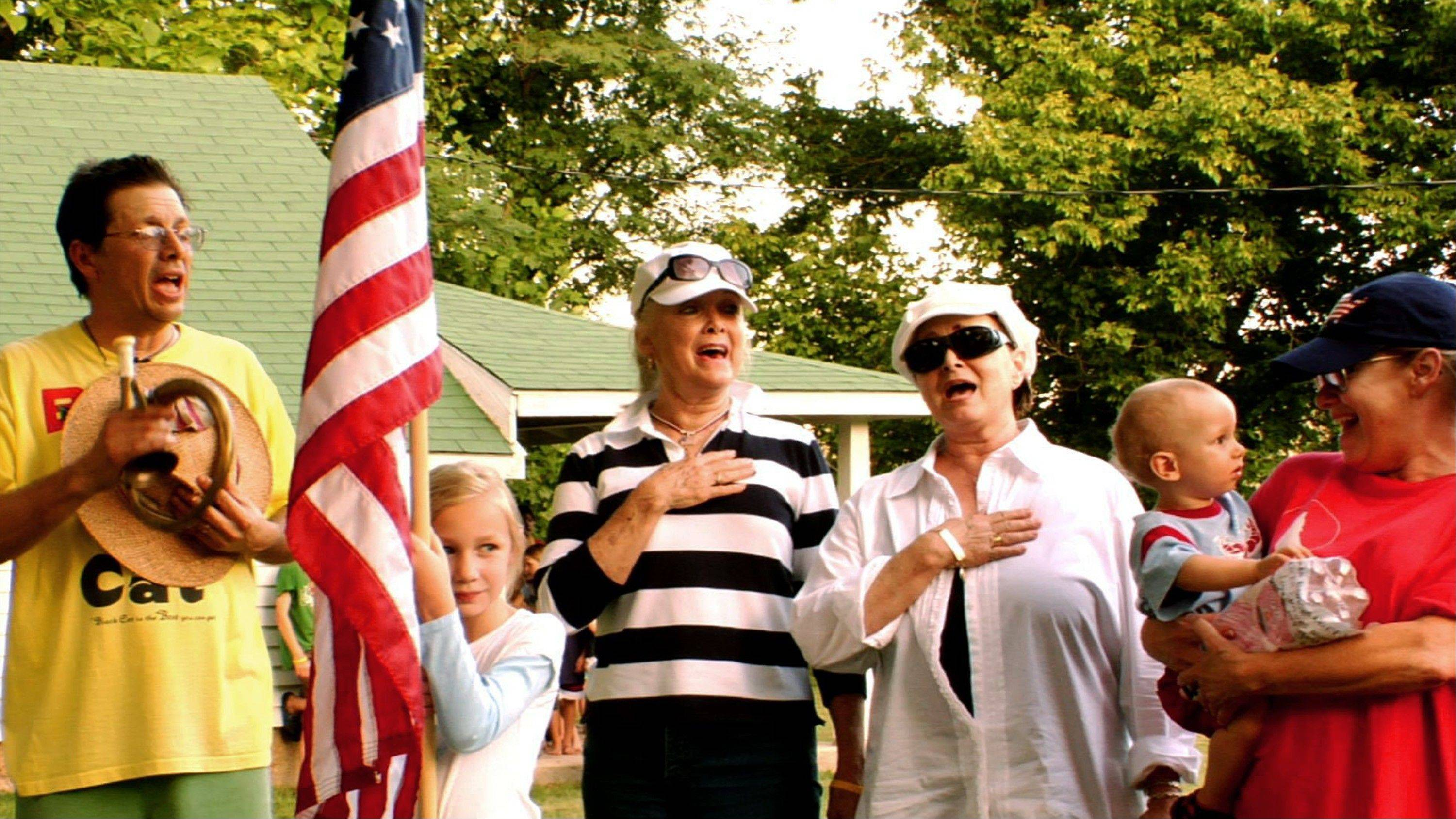 "In this July 4, 2008 image from video, Bill Lennon, left, and his sisters Diane, center left, Peggy, center right, and Janet, right, who were a household name to millions during their heyday on the Lawrence Welk show, sing ""The Star-Spangled Banner"" on the family ranch near Branson, Mo. The Lennon's are one of four families living in the Branson area that documentary filmmakers David Wilson and A.J. Schnack followed over five years to produce ""We Always Lie to Strangers,"" a middle-America, flag-waving, family-friendly celebration of musical variety shows and early-bird dinner specials. The documentary will be distributed nationally in 2014."
