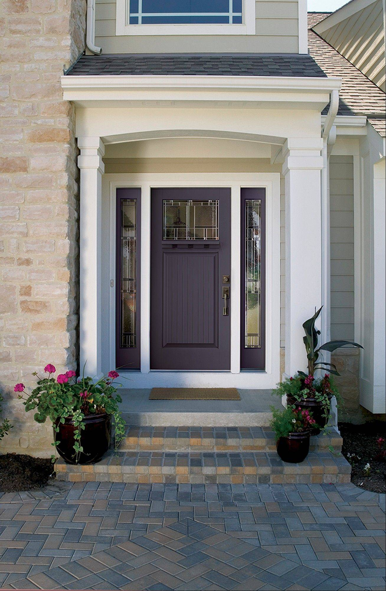 A quixotic plum front door with homeward glass. Color expert Kate Smith predicts we'll see more homes with doors painted in tropical blues, energetic oranges and deep purples in 2014.