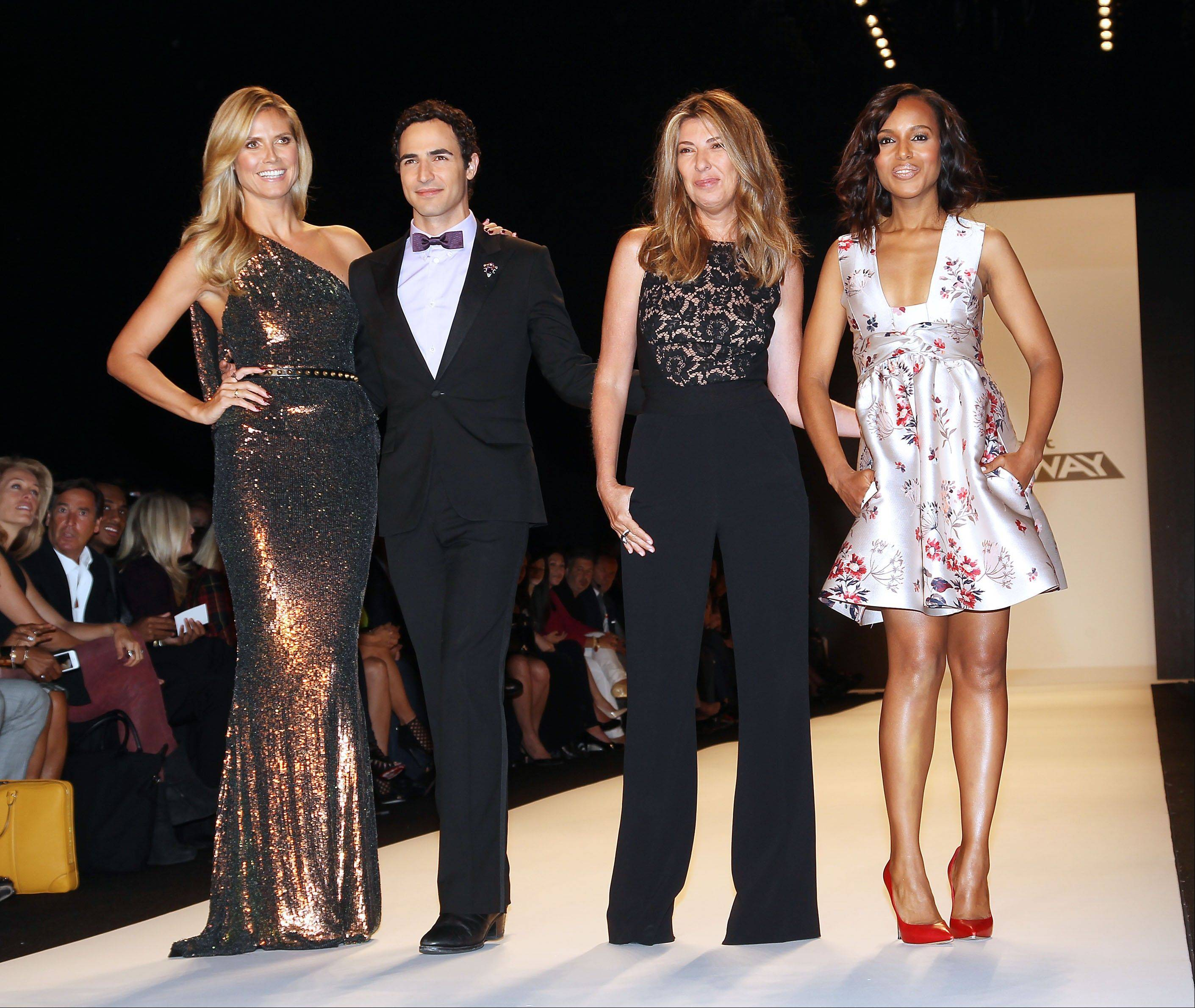 "This Sept. 6, 2013 file image released by Starpix shows, from left, host Heidi Klum, designer Zac Posen, Nina Garcia and actress Kerry Washington wearing a Stella McCartney floral frock and red leather pumps as a judge, at the ""Project Runway"" show during Fashion Week in New York. In the realm where Hollywood meets fashion, Kerry Washington is royalty. On her hit show ""Scandal,"" playing professional fixer Olivia Pope, she was all professional Washington _ Washington, D.C., that it _ but on the red carpet, she was glamour personified."