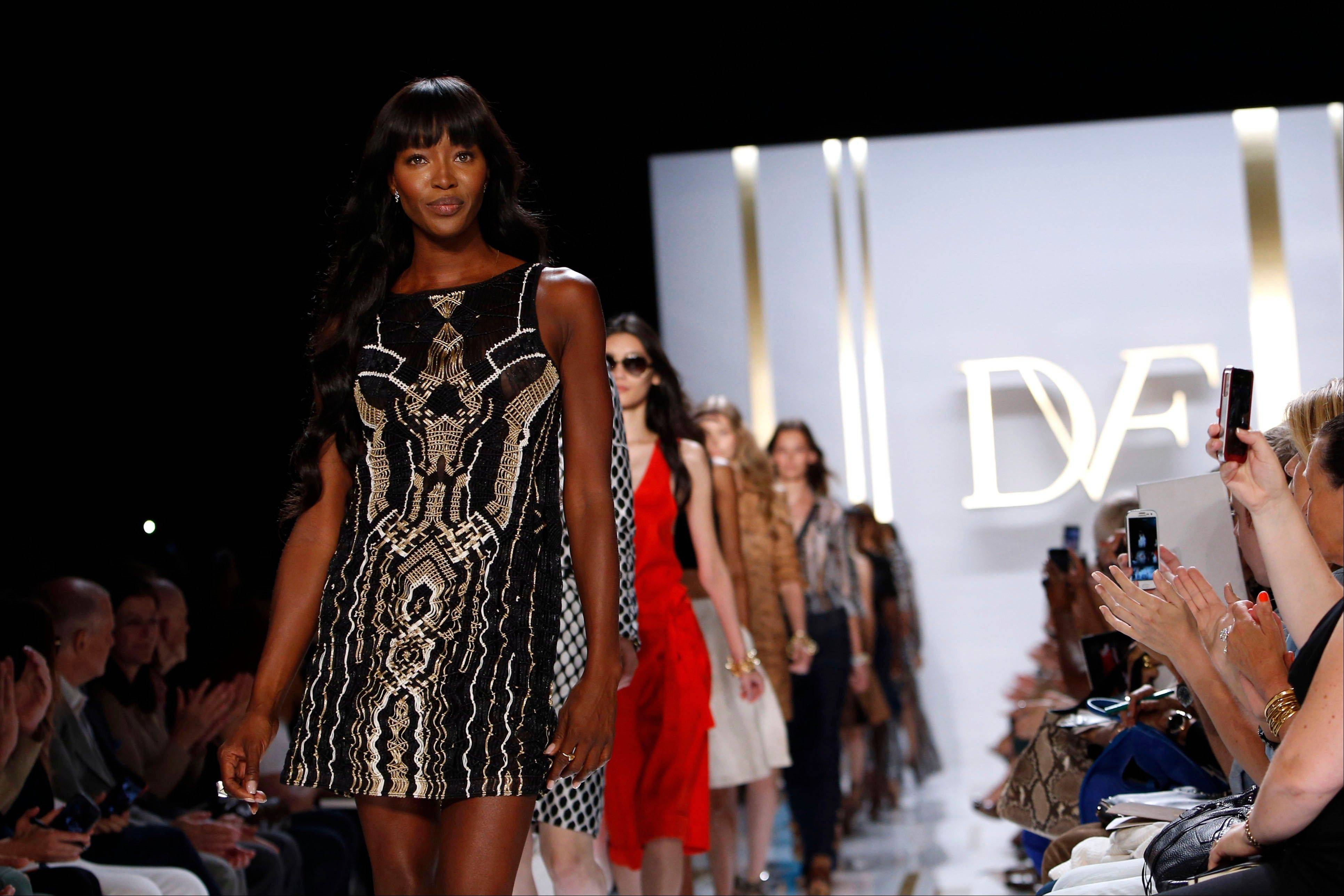 This Sept. 8, 2013 file photo shows model Naomi Campbell walking the runway in the Diane von Furstenburg Spring 2014 collection show during Fashion Week in New York. Iman and Naomi Campbell are legendary supermodels, but this year they lent themselves to something different: promoting diversity on the runway, by calling out designers whose catwalks were almost completely white. The two women joined modeling agent Bethann Hardison in their Balance Diversity campaign. Iman, now 58, said she was shocked to hear that there were fewer black models on the runway than when she stopped modeling in 1989.