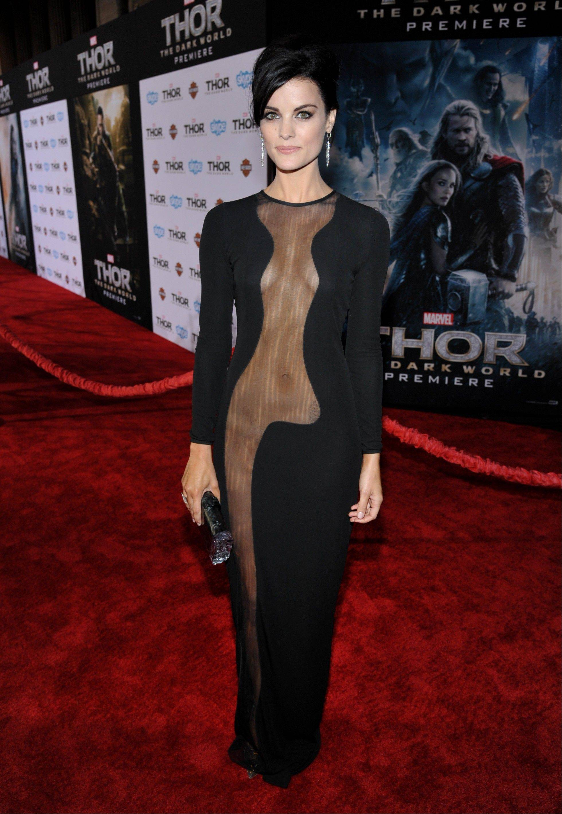 "This Nov. 4, 2013 file photo shows actress Jaimie Alexander at the U.S. premiere of ""Thor: The Dark World"" in Los Angeles. Alexander wore a black Azzaro Couture dress expanding the see-through effect to the midriff and upper regions."