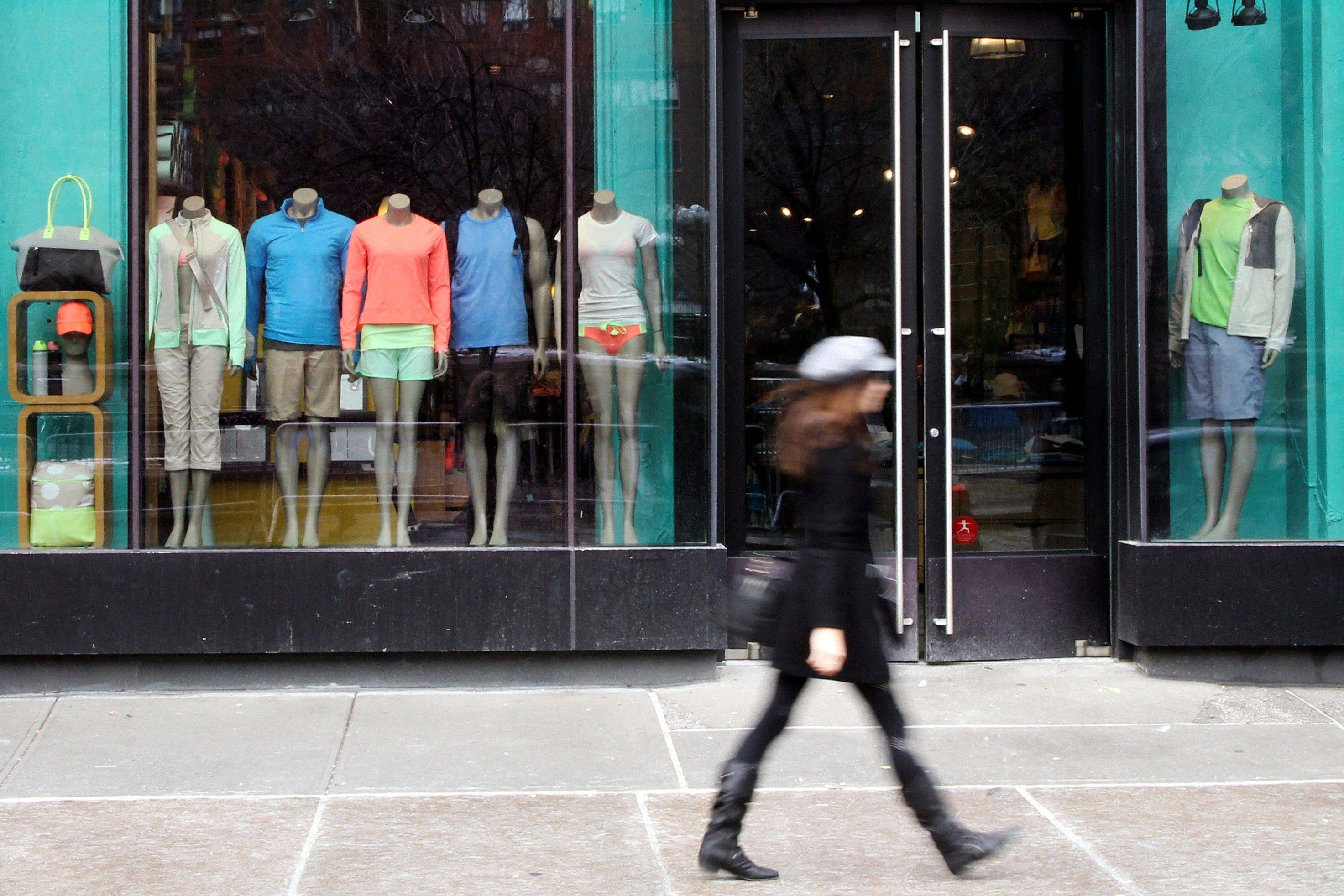 This March 19, 2013 file photo shows a pedestrian walking past the Lululemon Athletica store at Union Square in New York. Lululemon yanked its popular black yoga pants from store shelves after it found that the sheer material used was revealing too much of its loyal customers.
