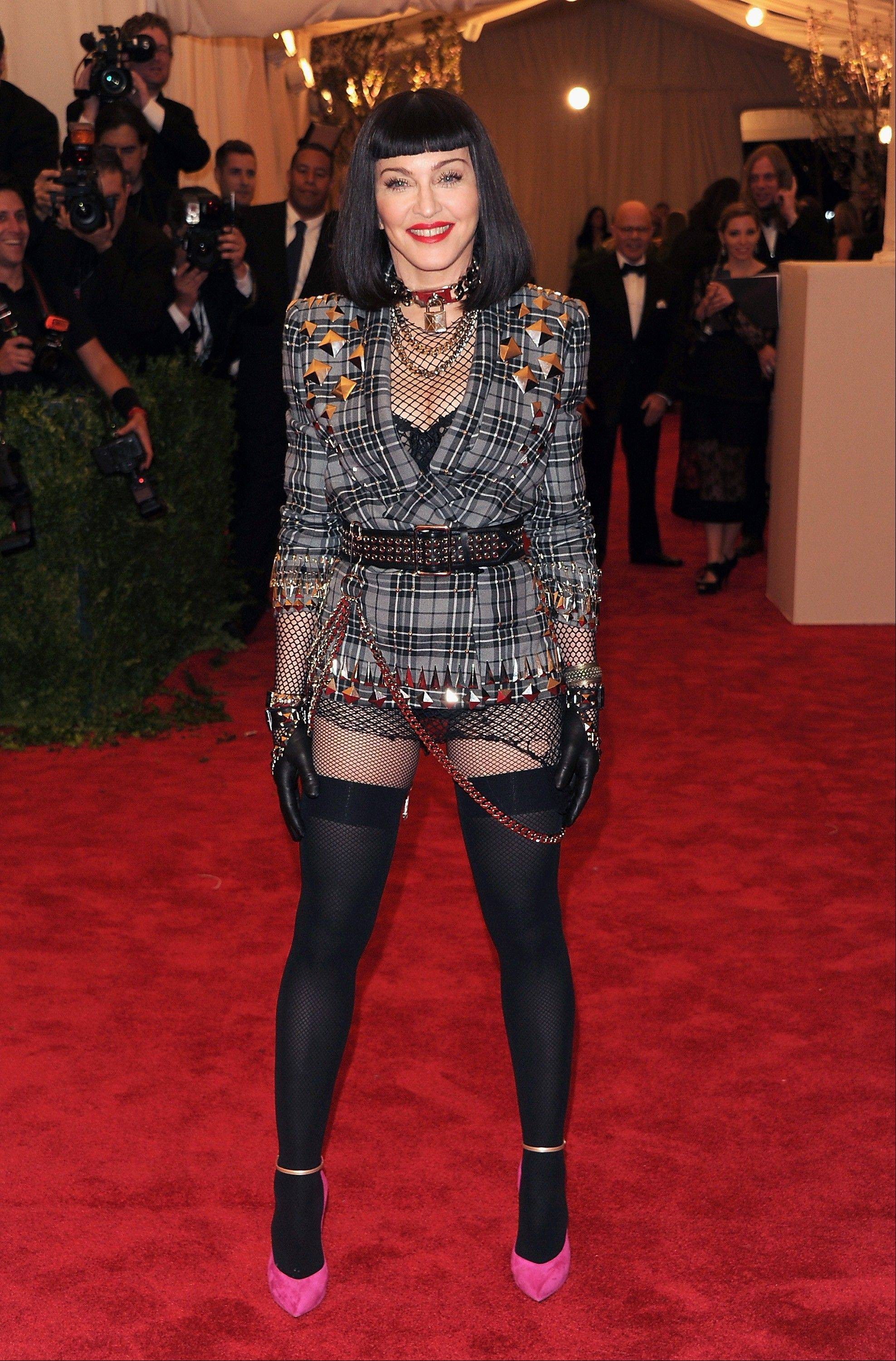 "This May 6, 2013 file photo shows Madonna at The Metropolitan Museum of Art Costume Institute gala benefit, ""Punk: Chaos to Couture"" in New York. The Metropolitan Museum of Art hosted a new Costume Institute exhibit, ""Punk: Chaos to Culture,"" celebrating a movement that embraced anarchy in the 1970s."