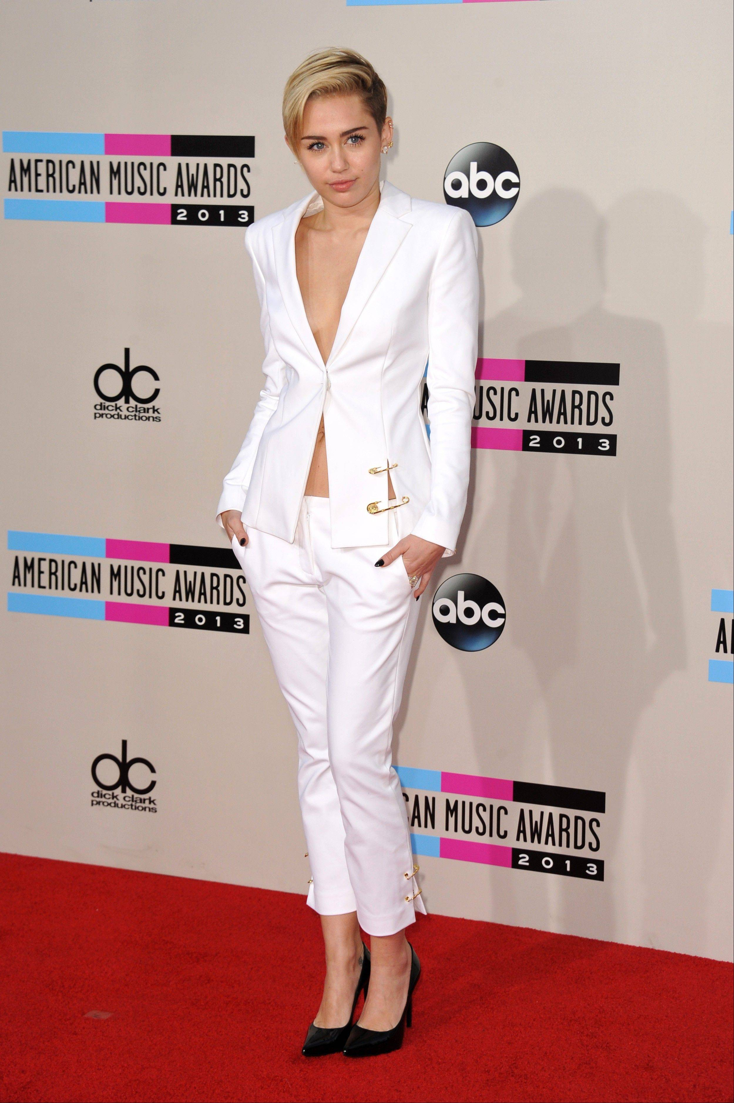 This Nov. 24, 2013 file photo shows Miley Cyrus at the American Music Awards in Los Angeles. It must be mentioned that Miley Cyrus embodied more than one fashion trend this year. Is Cyrus becoming a fashion icon? Not by the standard definition. But heading into 2014 she was one of the most-watched people on the planet