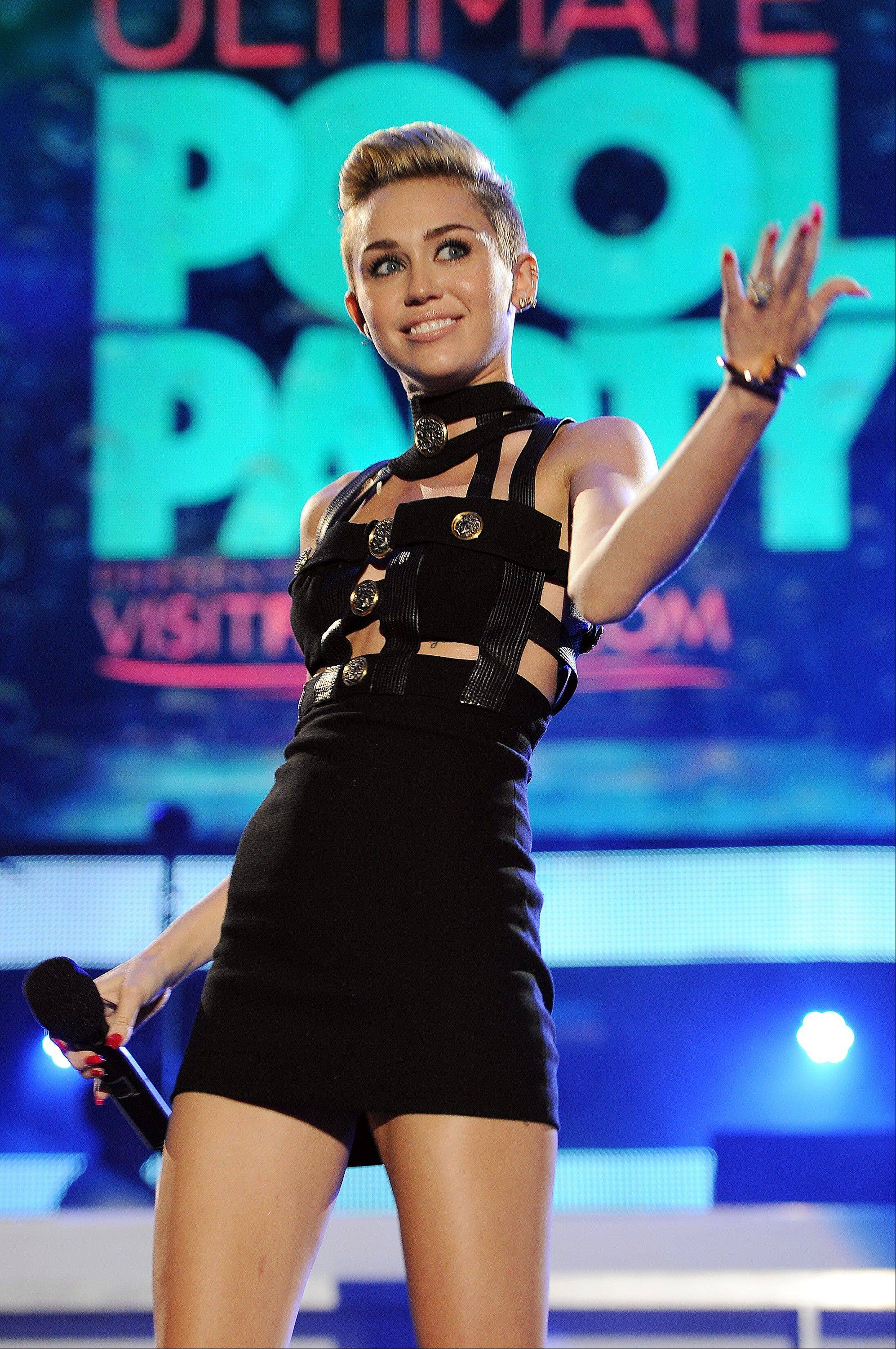 This June 29, 2013 file photo shows Miley Cyrus hosting the iHeartRadio Ultimate Pool Party at the Fontainebleau Hotel in Miami. It must be mentioned that Miley Cyrus embodied more than one fashion trend this year. Is Cyrus becoming a fashion icon? Not by the standard definition. But heading into 2014 she was one of the most-watched people on the planet.