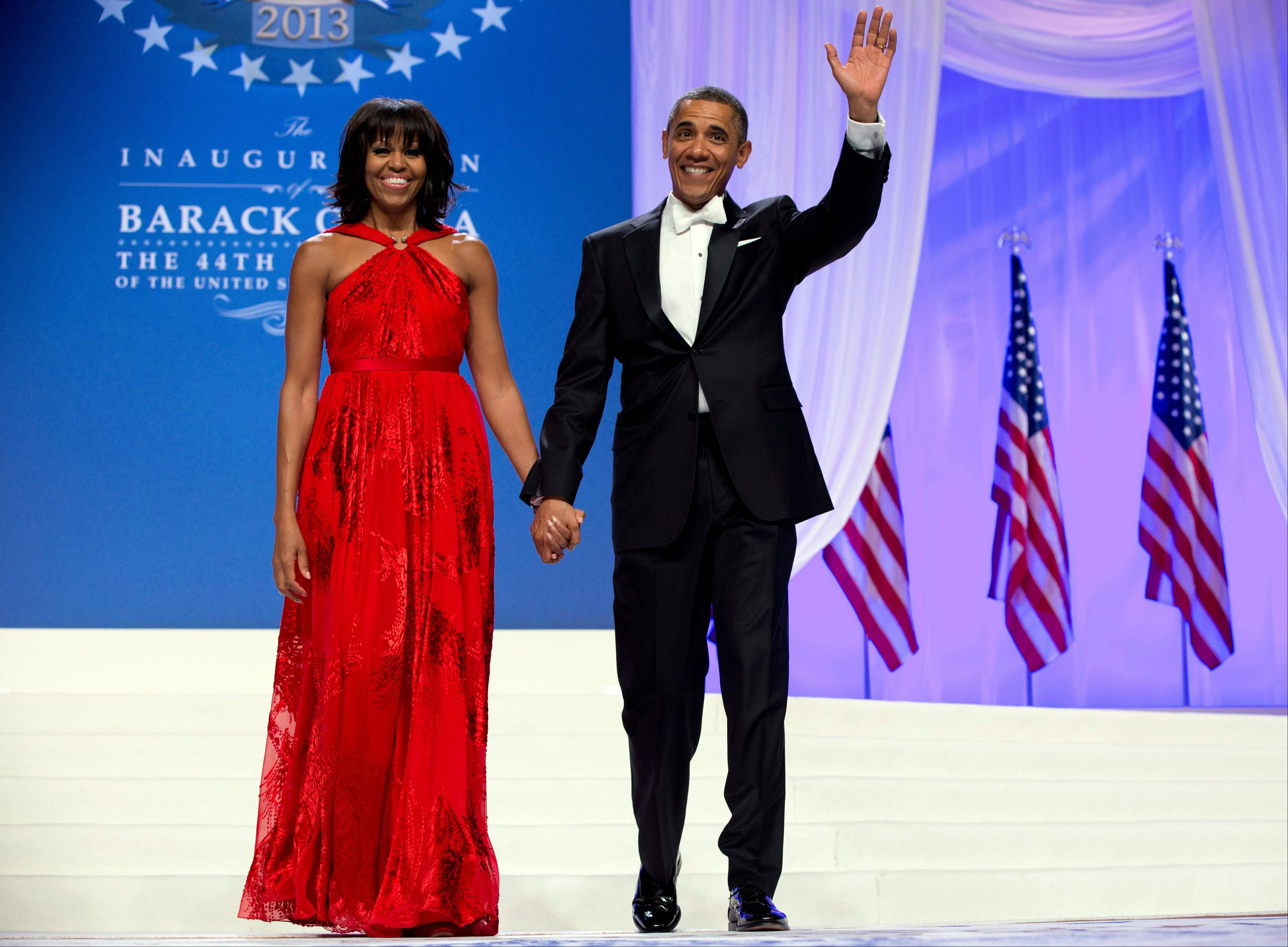 This Jan. 21, 2013 file photo shows President Barack Obama and first lady Michelle Obama at an Inaugural Ball at the Washington Convention Center in Washington, during the 57th Presidential Inauguration. Nobody would call bangs a new trend, but when the first lady's involved, things take on more significance. In fact, President Barack Obama did call his wife Michelle's new hairdo the most significant event of his second inauguration.