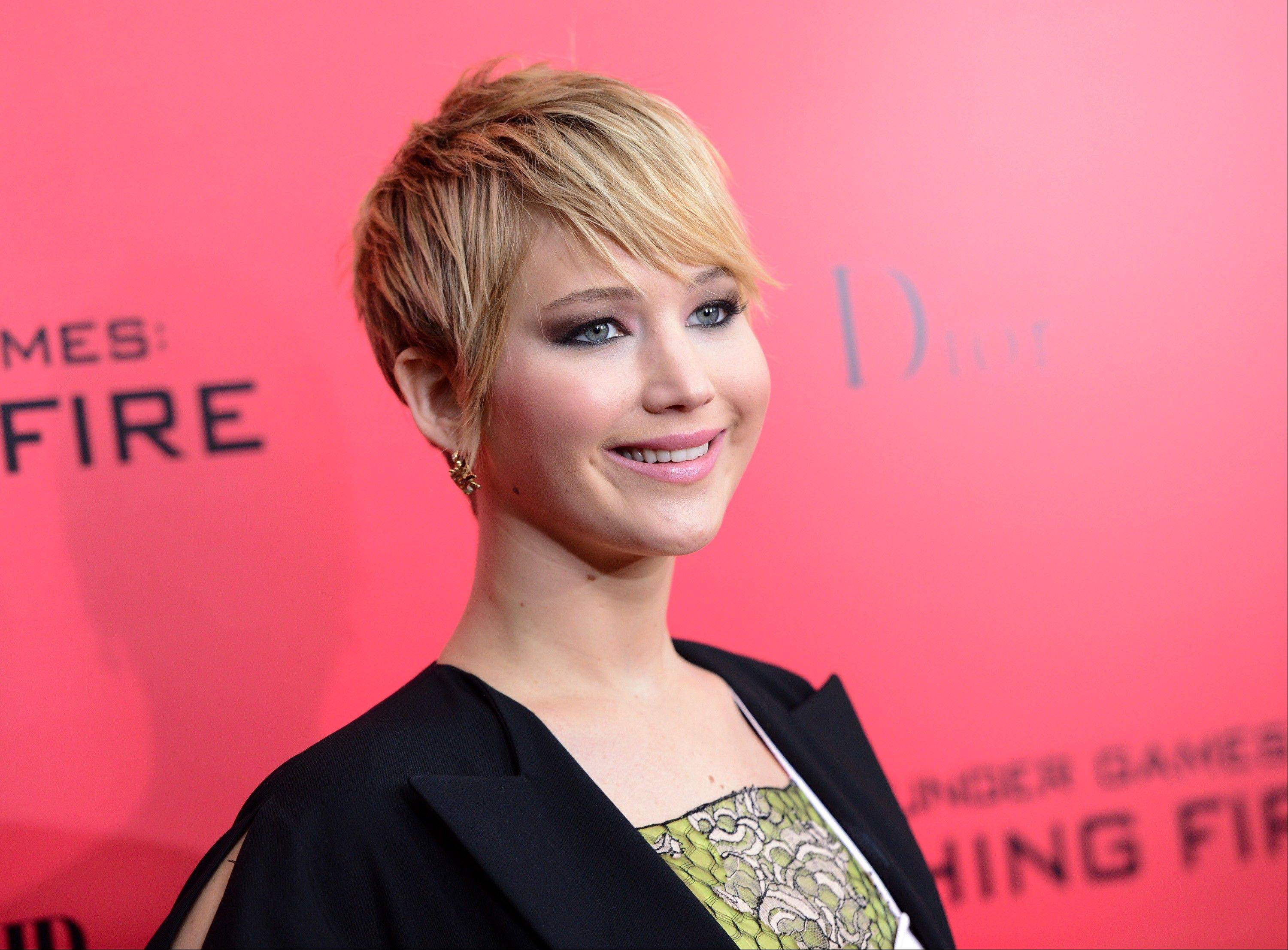 "This Nov. 20, 2013 file photo shows actress Jennifer Lawrence sporting a pixie haircut at a special screening of ""The Hunger Games: Catching Fire""in New York."