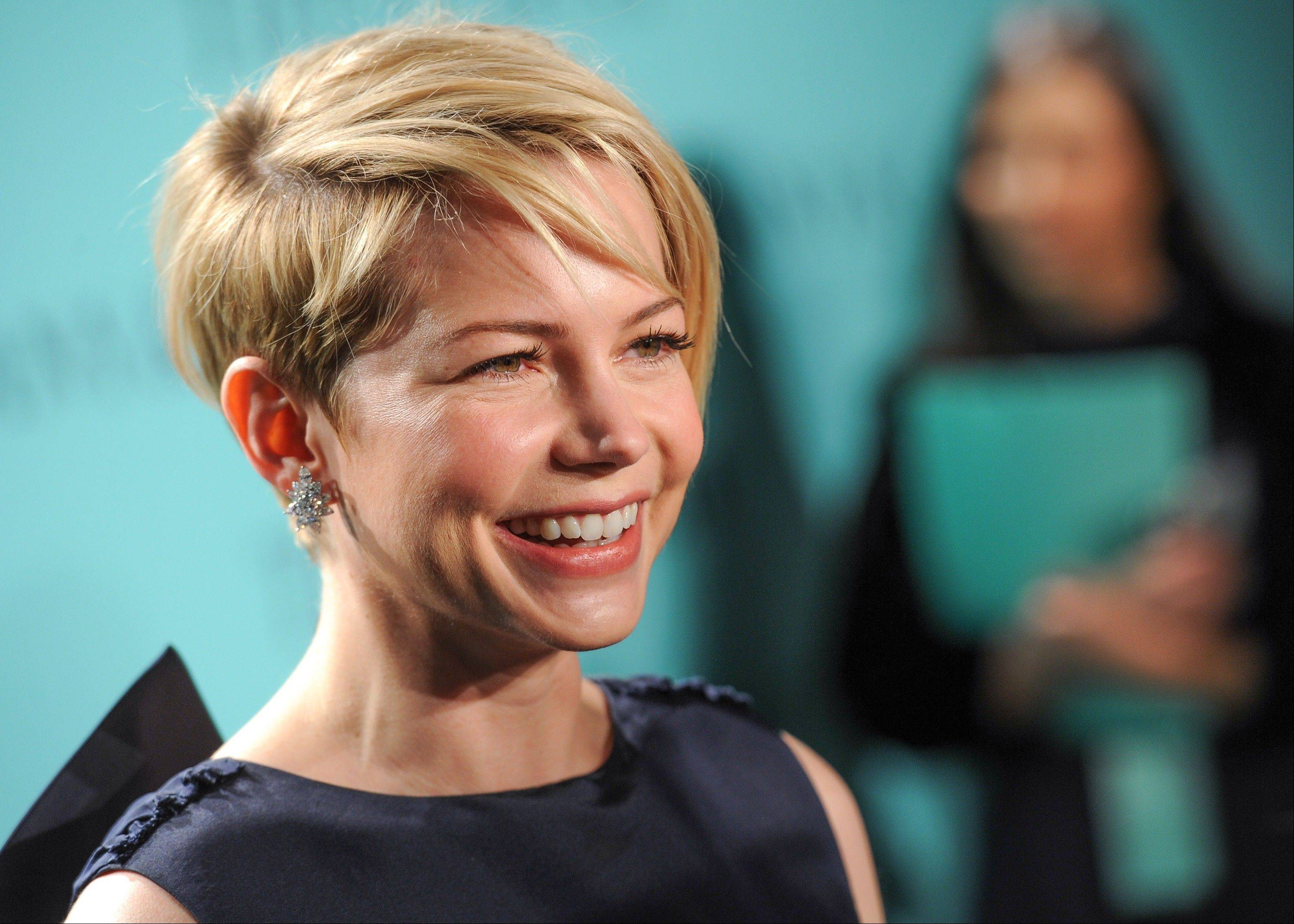 This April 18, 2013 file photo shows actress Michelle Williams sporting a pixie haircut at the Tiffany & Co. Blue Book Ball in New York.