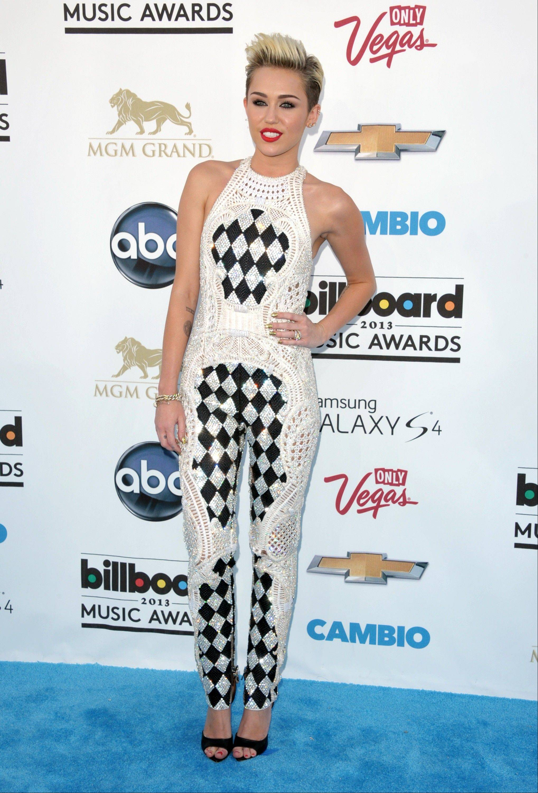 This May 19, 2013 file photo shows Miley Cyrus at the Billboard Music Awards at the MGM Grand Garden Arena in Las Vegas. It must be mentioned that Miley Cyrus embodied more than one fashion trend this year. Is Cyrus becoming a fashion icon? Not by the standard definition. But heading into 2014 she was one of the most-watched people on the planet.