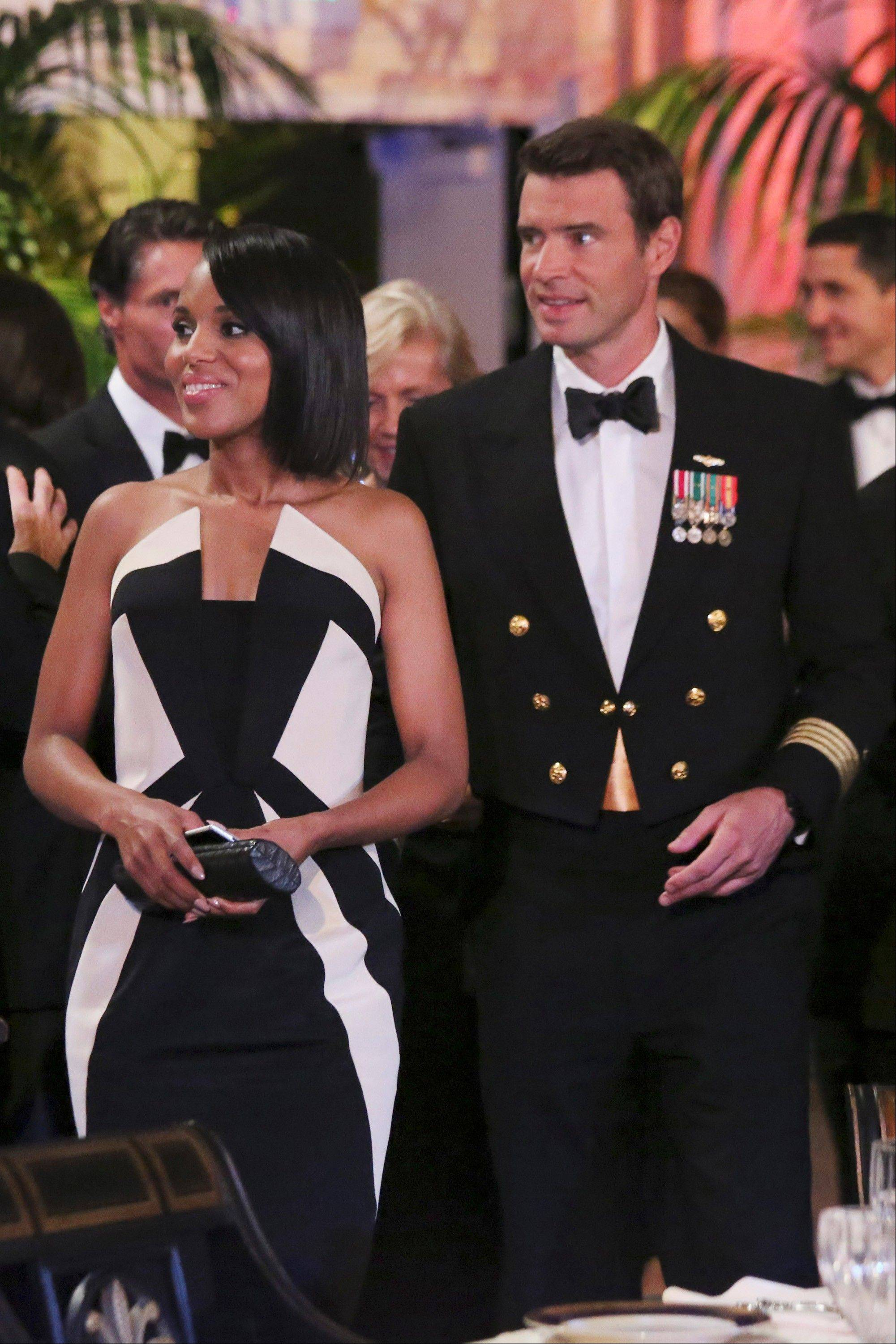 "In this image released by ABC actress Kerry Washington wears a Rubin Singer gown, left, with Scott Foley in a scene from ""Scandal."" In the realm where Hollywood meets fashion, Kerry Washington is royalty. On her hit show ""Scandal,"" playing professional fixer Olivia Pope, she was all professional Washington _ Washington, D.C., that it _ but on the red carpet, she was glamour personified."